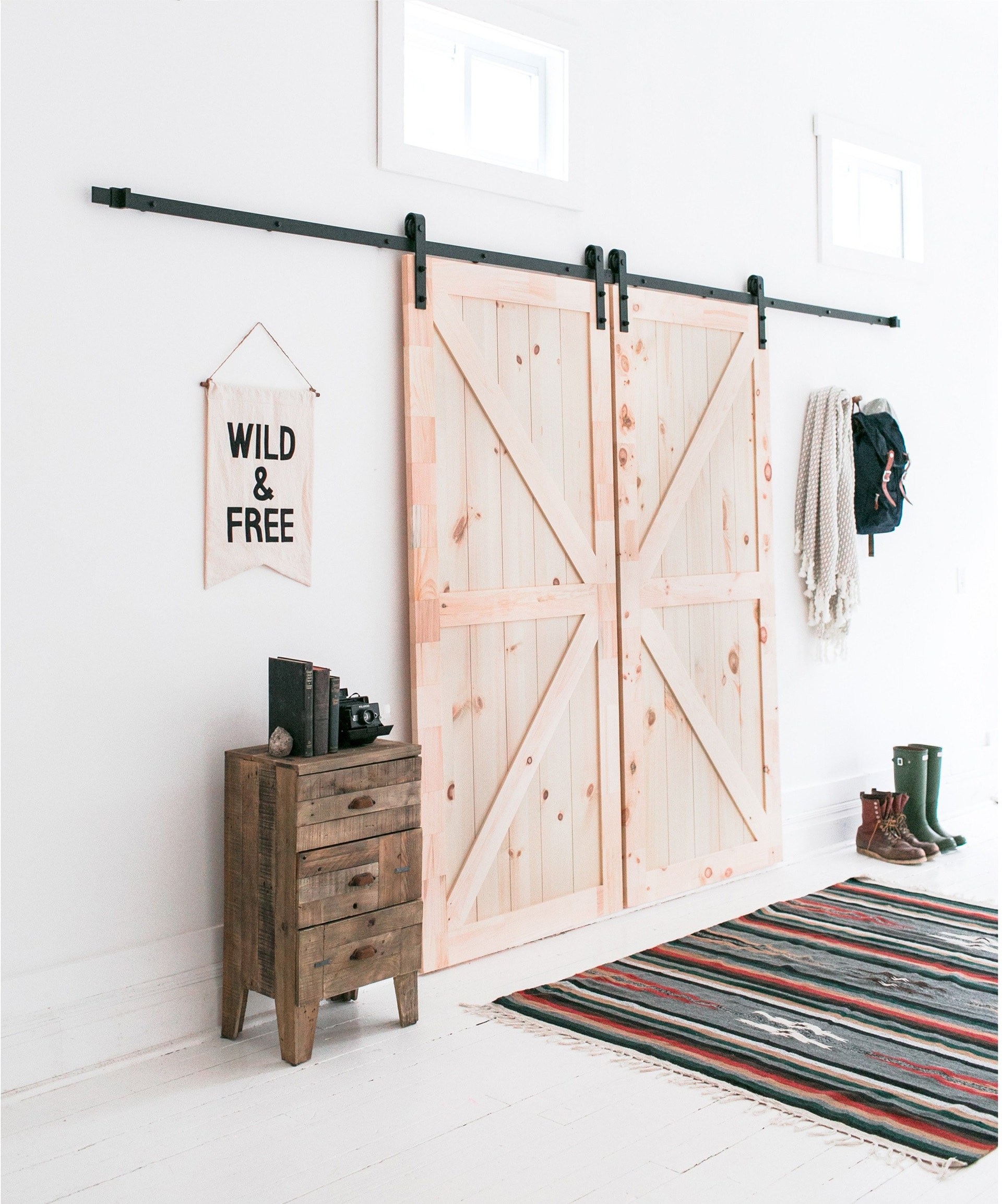 internal sliding barn door in bohemian living room raw pine