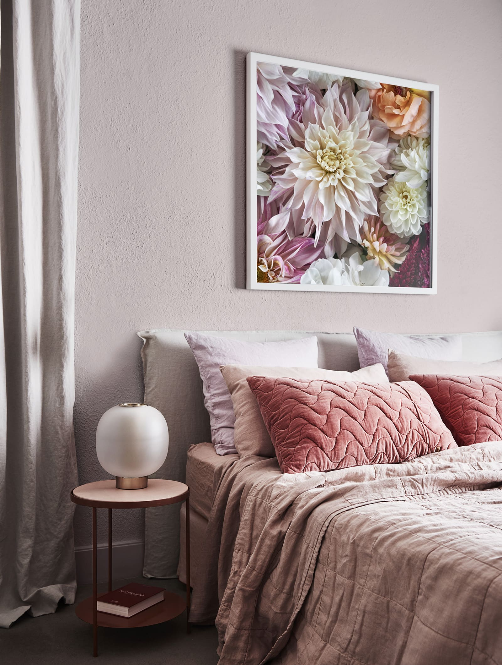 light pink bedroom with floral artwork above bed and quilted cushion covers dulux forecast