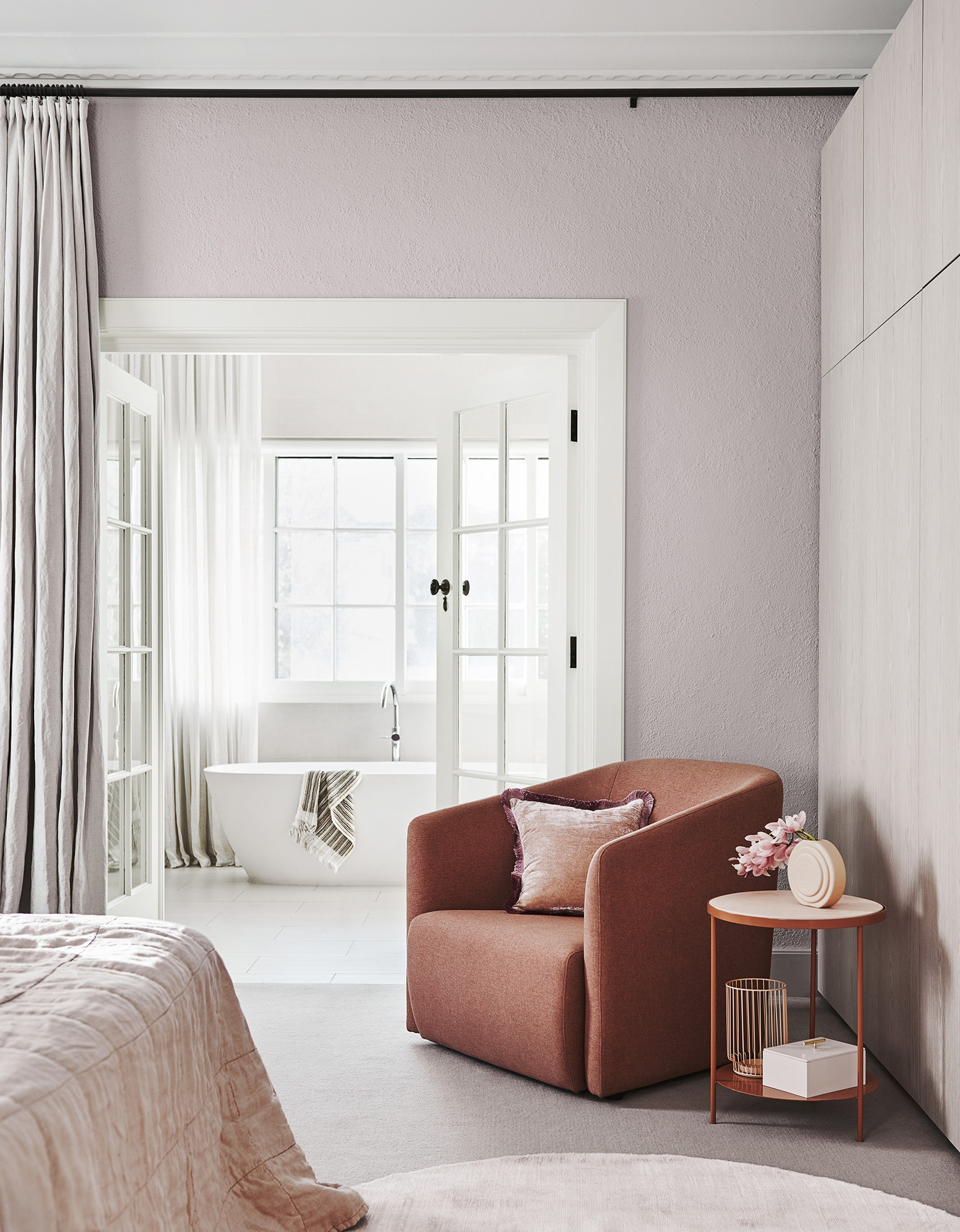 light pink bedroom with white trims and terracotta coloured armchair dulux colour forecast