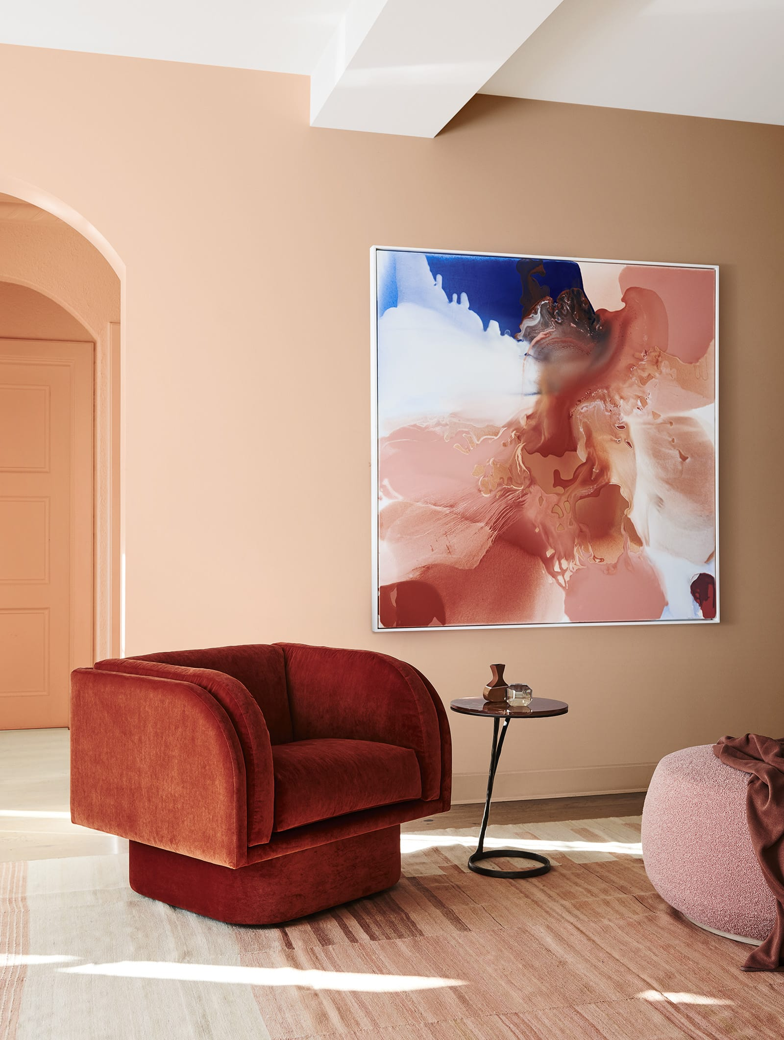 living room with coral walls and red amrchair dulux warm paint colours