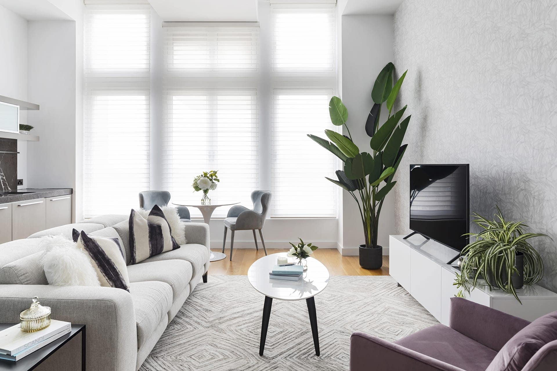 Melbourne apartment make over with grey recliner sofa from Plush and blinds from Luxaflex