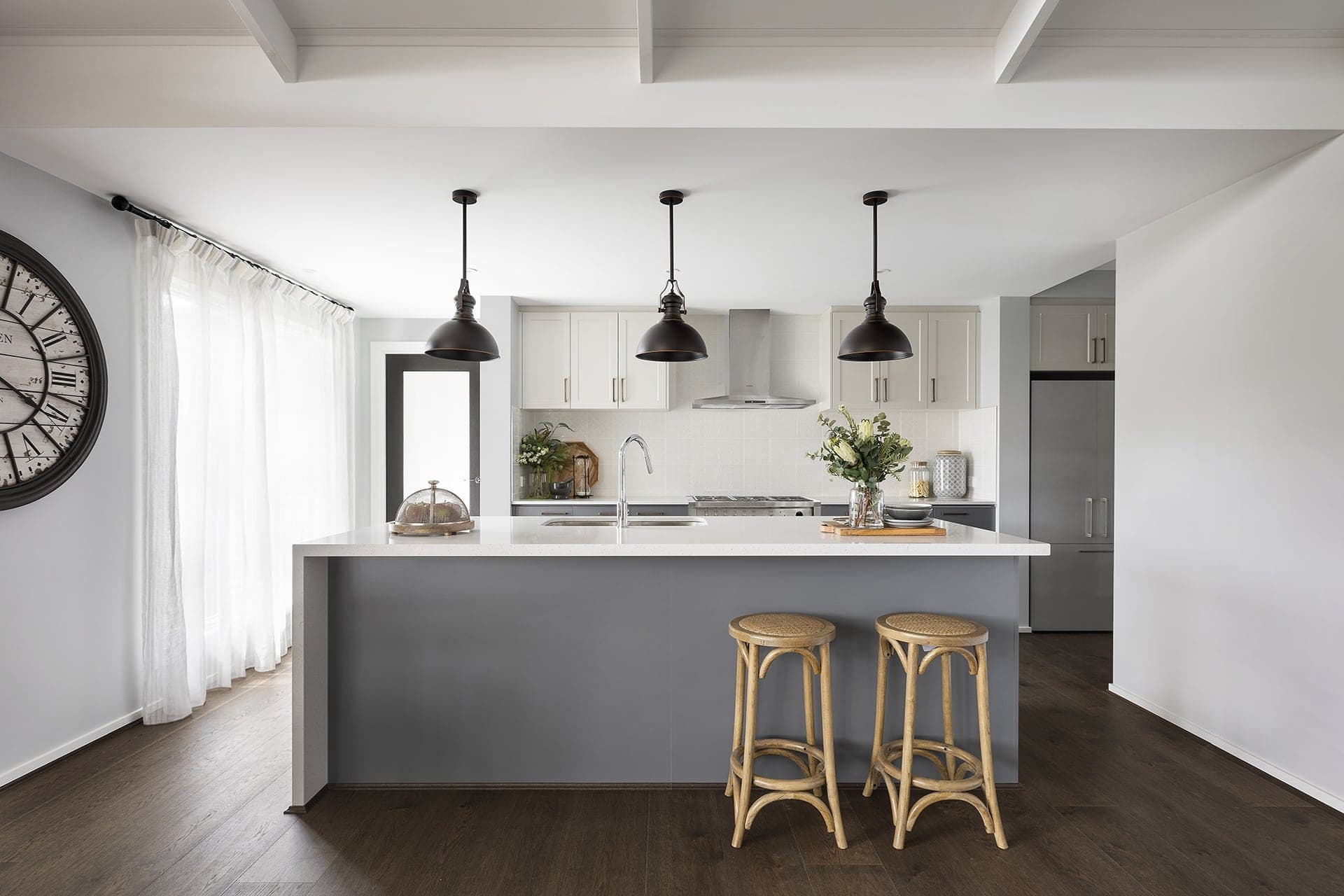 modern country style kitchen with black pendant lights shaker cabinets and grey doors
