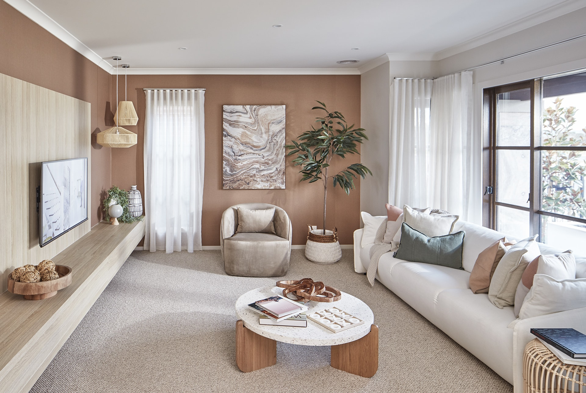 muddy green and terracotta living room in energy efficient home by metricon