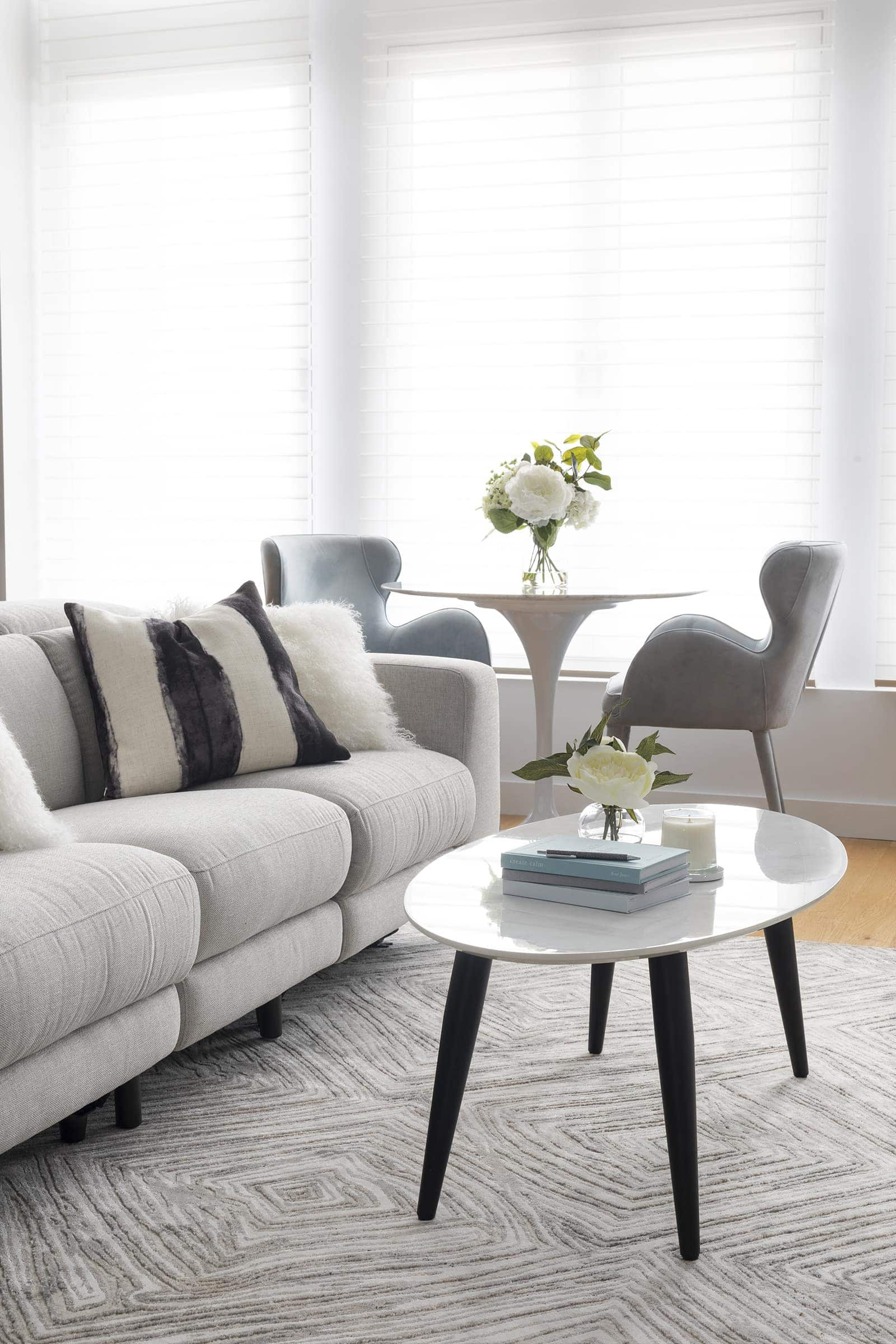 plush grey recliner sofa marble coffee table from fantastic furniture and diamond rug from the rug collection