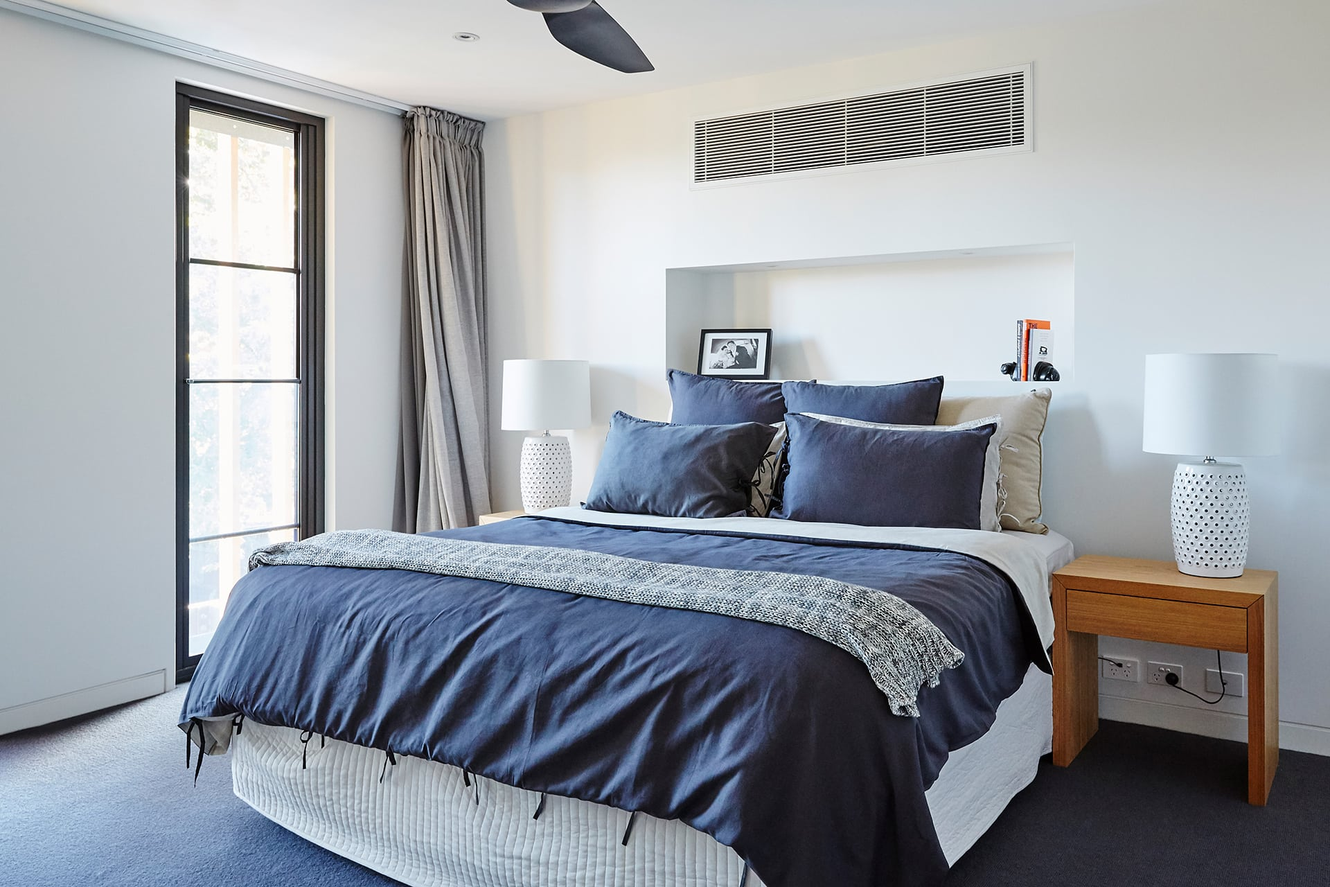 master bedroom with navy quilt cover set property styling melbourne