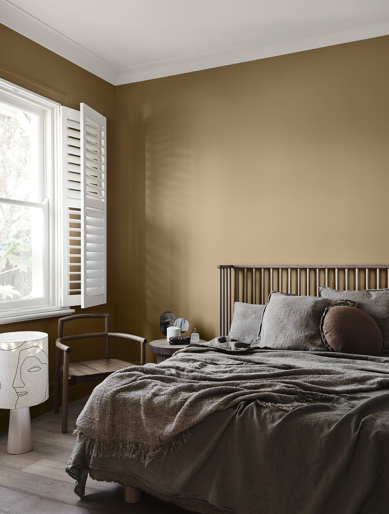 bedroom with caramel walls and dark brown bedspread neutral interior design scheme