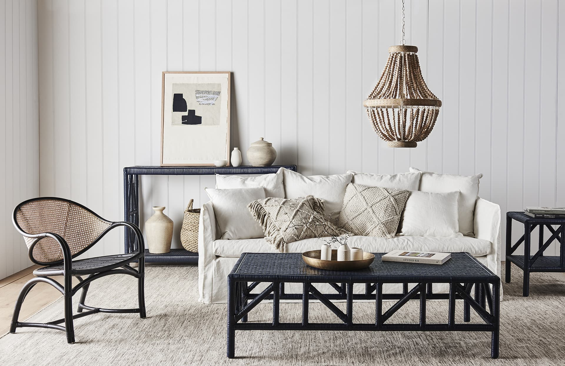 boho luxe interior design living room with cane chair and cane coffee table from globewest