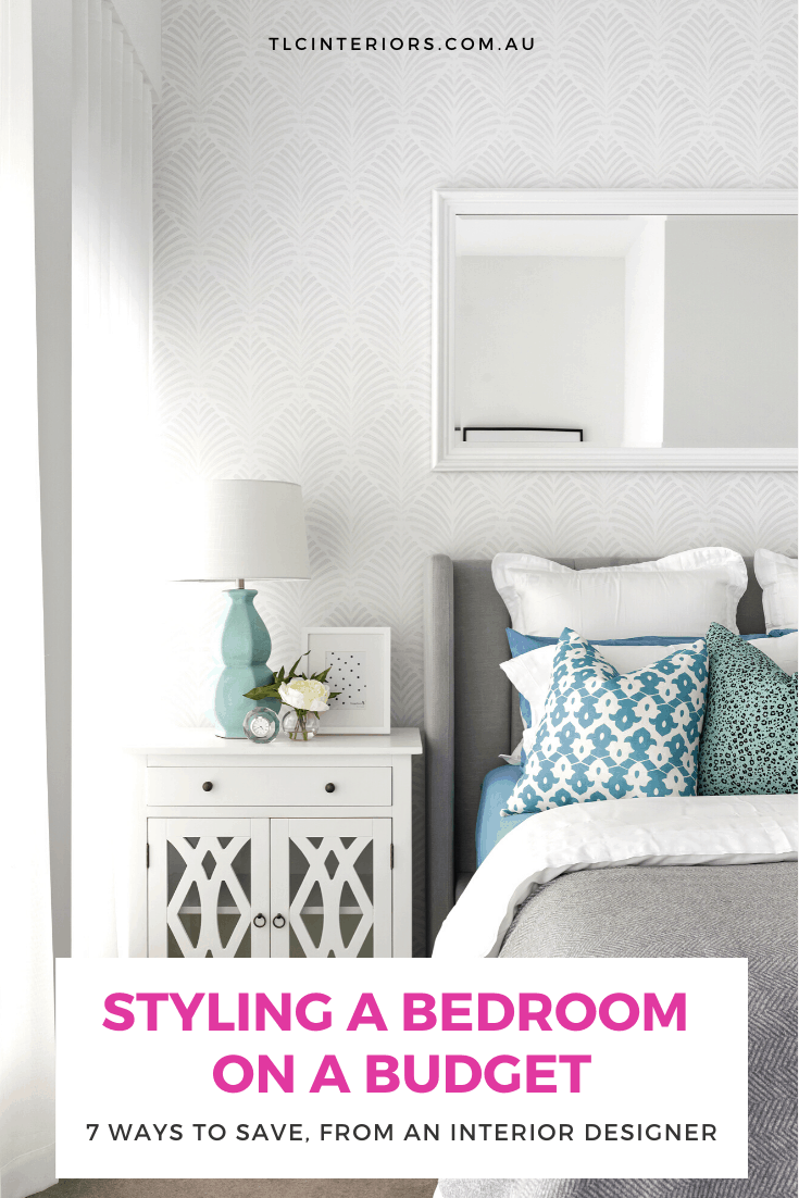 hamptons style bedroom with white bedside tables and art deco wallpaper