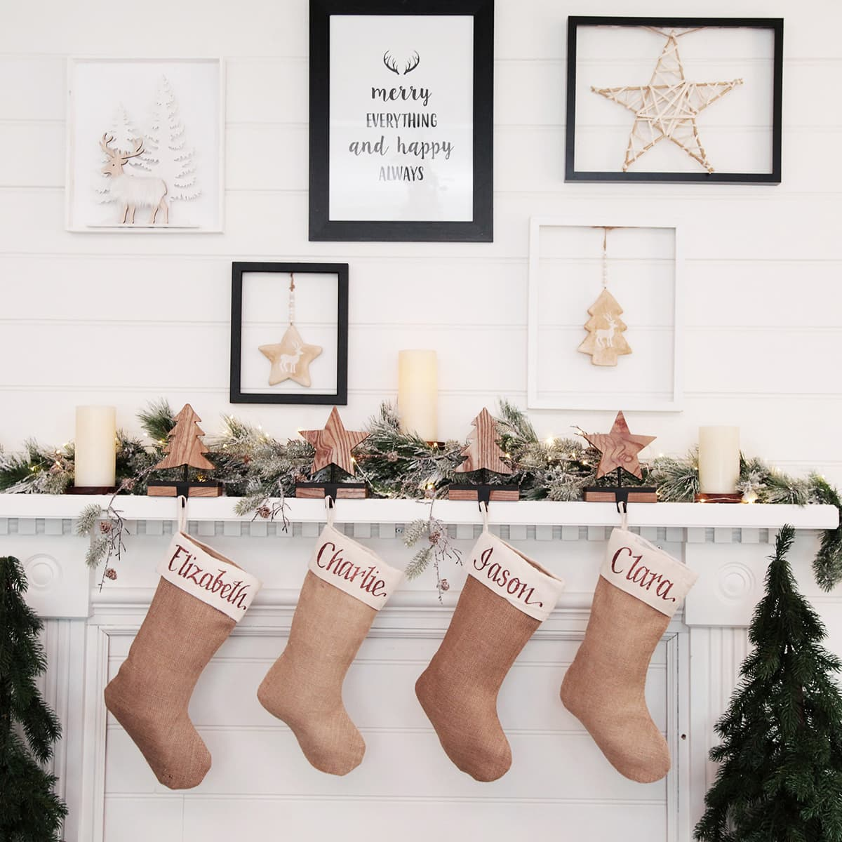 hessian personalised christmas stockings hanging on mantle by christmas cave