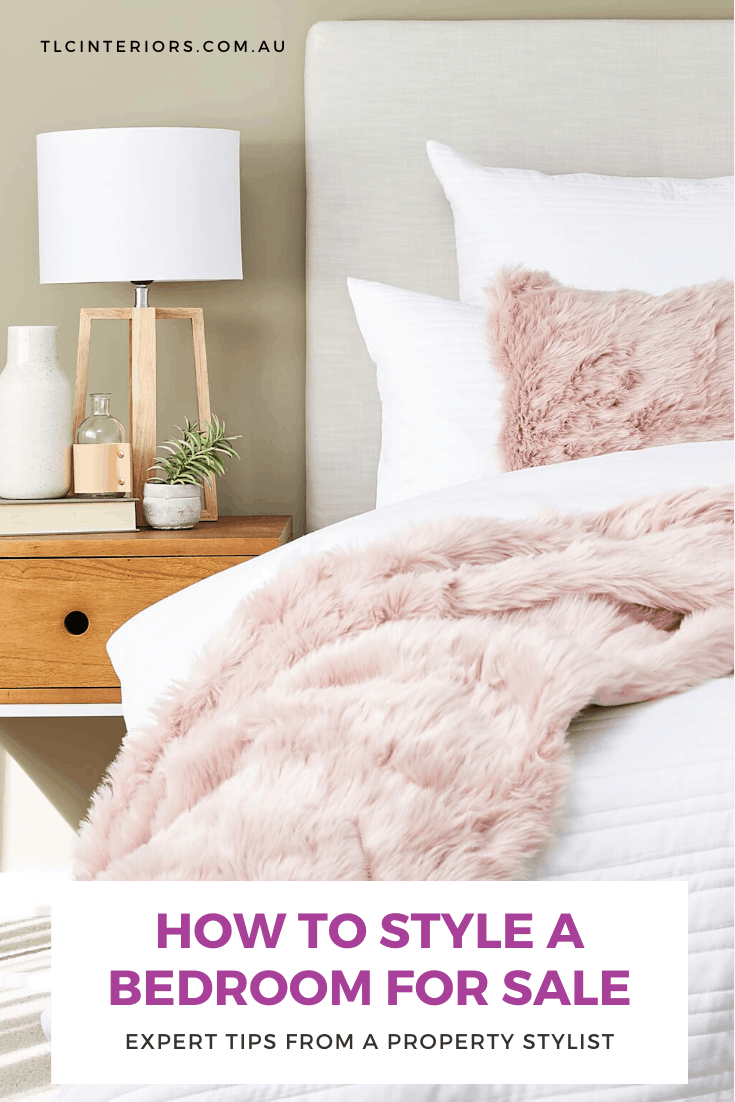 how to style a bedroom for sale with neutral bedding and blush pink cushions