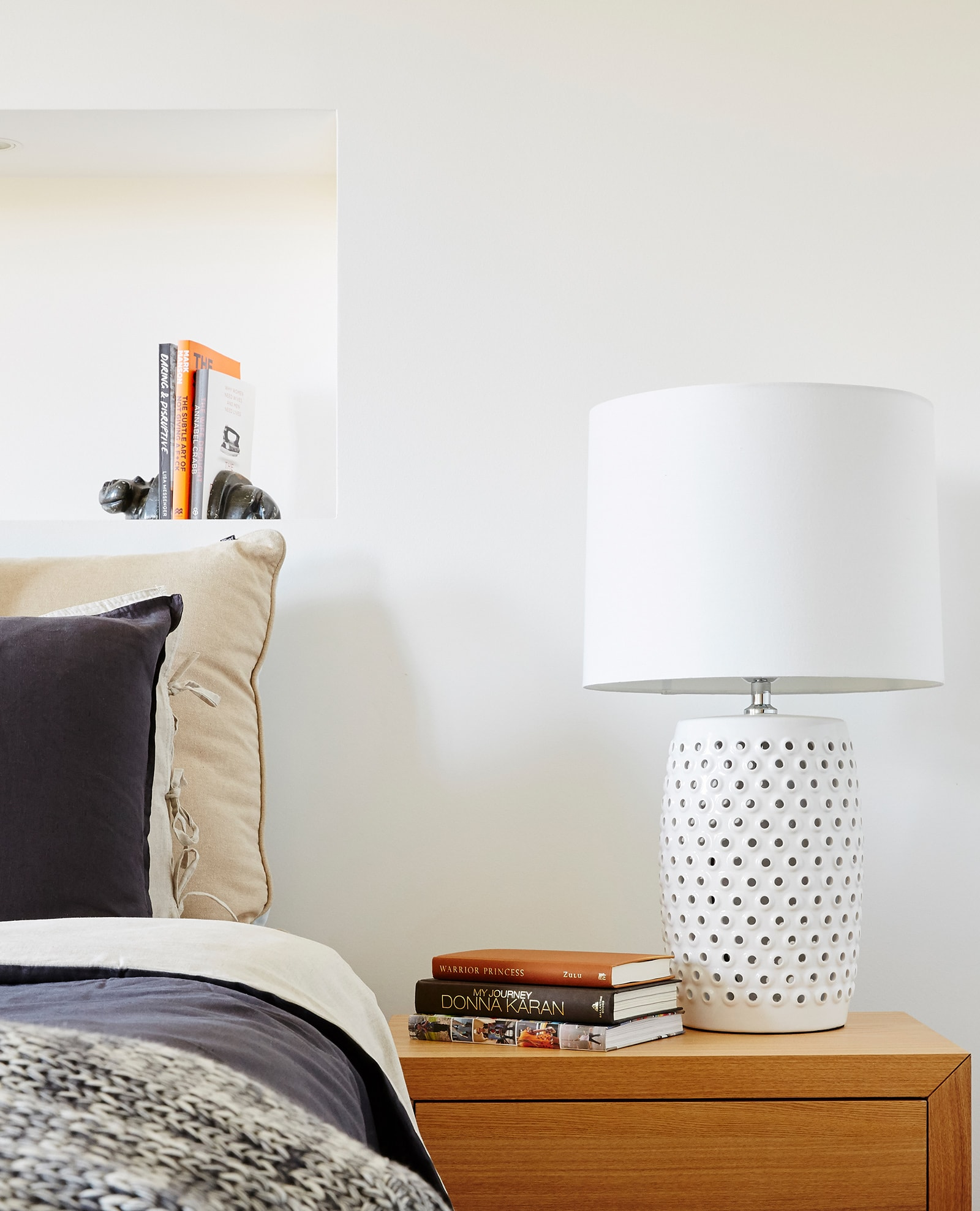 large white coastal lamp on bedside table in master bedroom