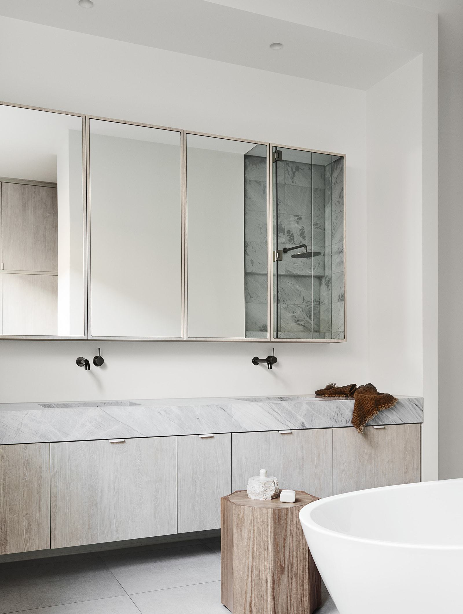 neutral interior design scheme bathroom with muted colour palette and timber side table