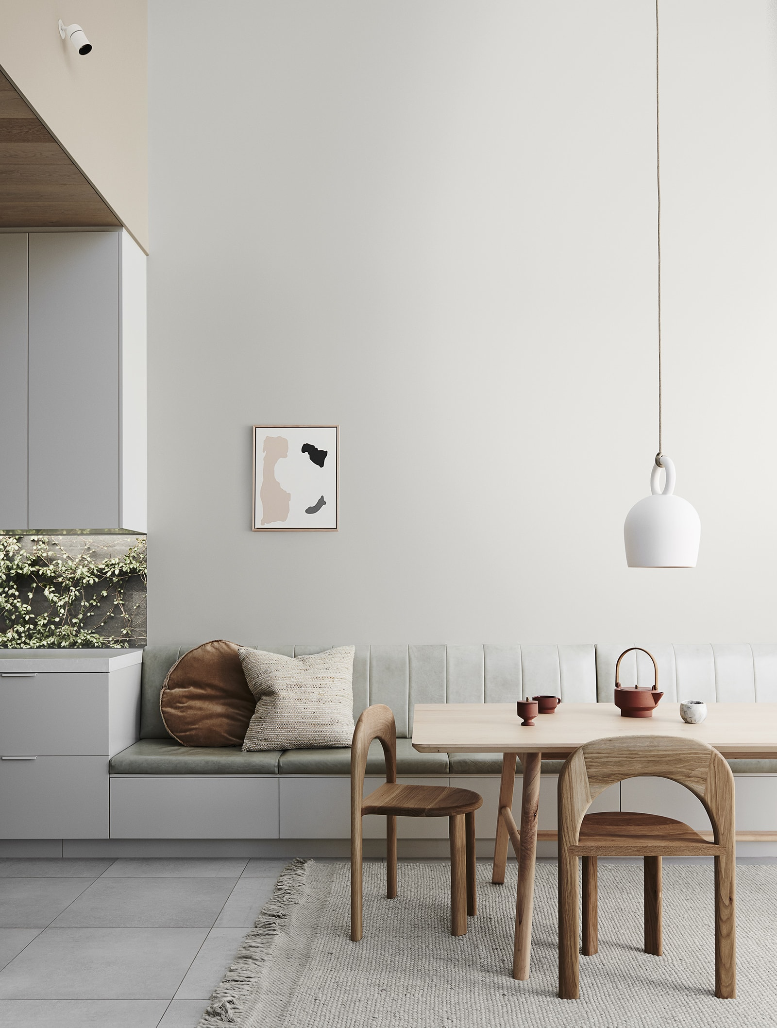 neutral interior design scheme dining roomw ith sage green banquette seating and oak dining table