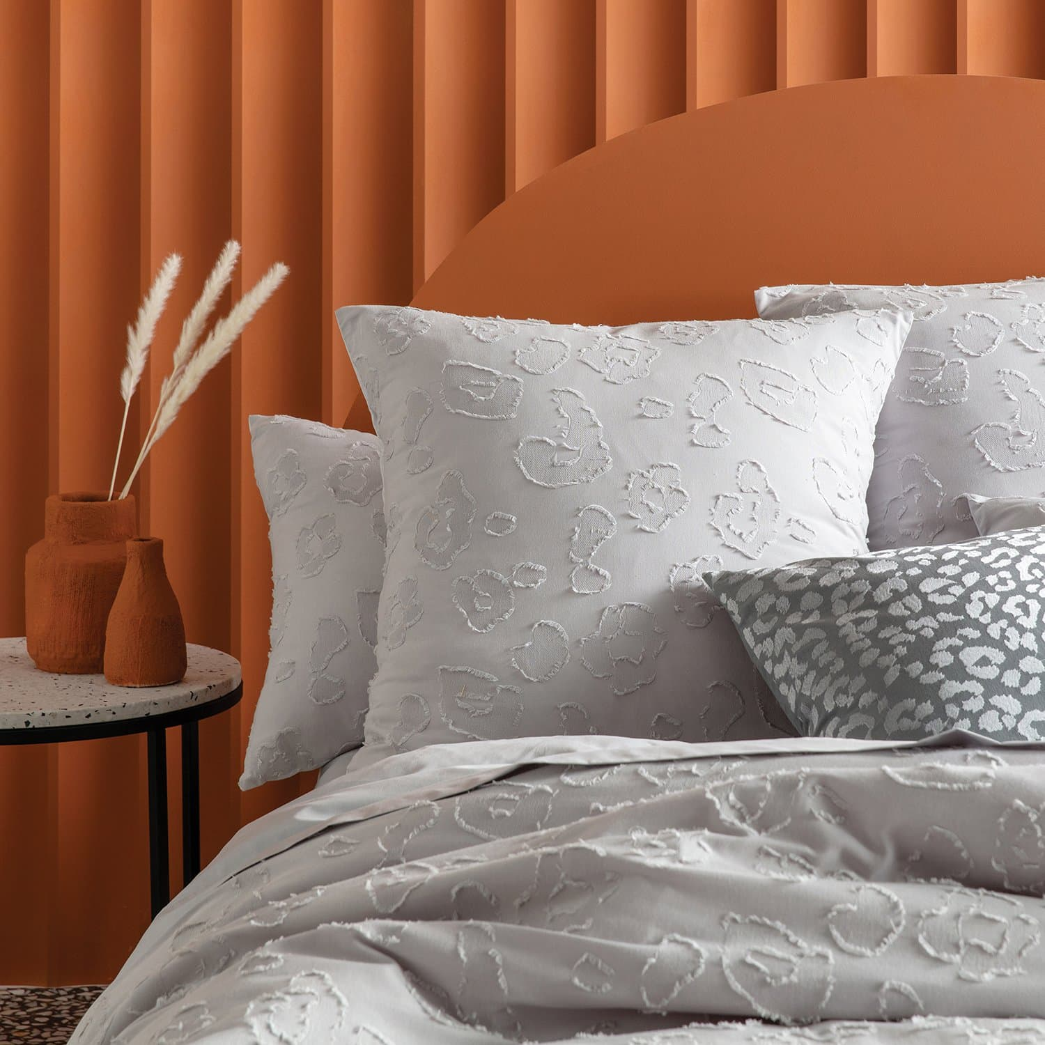 perry grey quilt cover set from KAS in orange bedroom