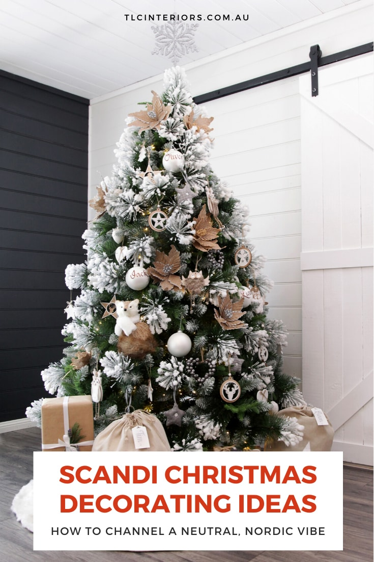 white tipped christmas tree with brown paper presents underneath christmas cave scandi christmas decorations