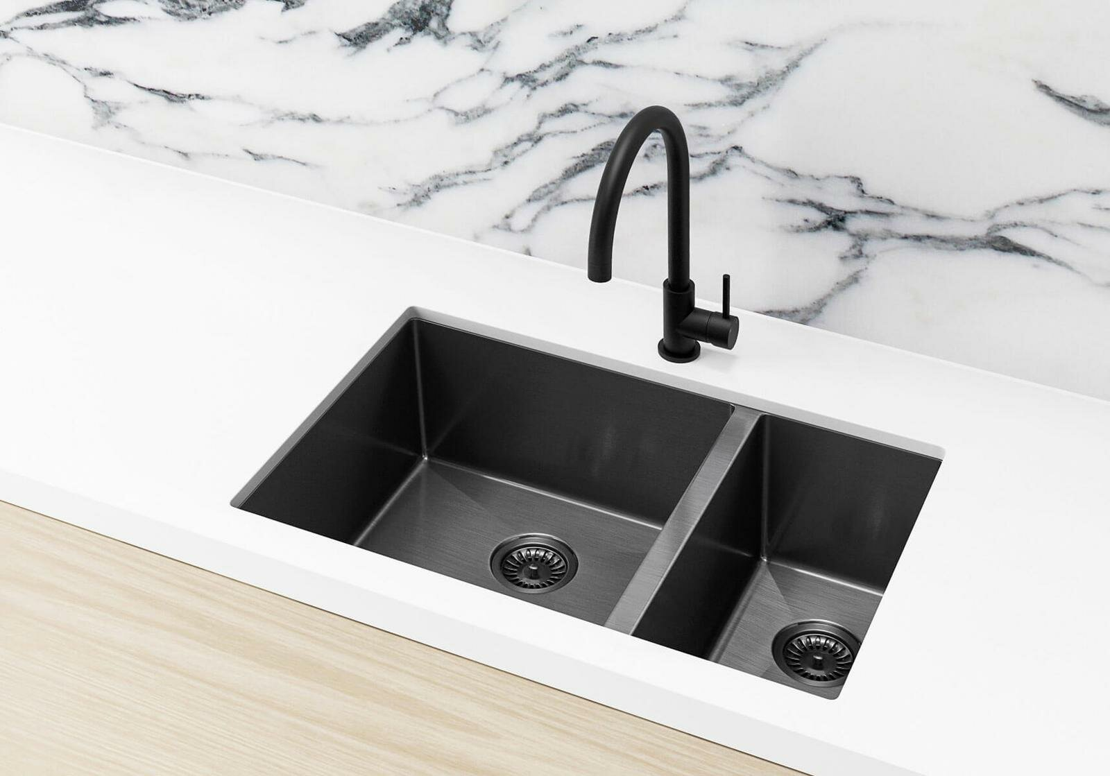 Meir black kitchen tap and sink on white marble countertop and splashback