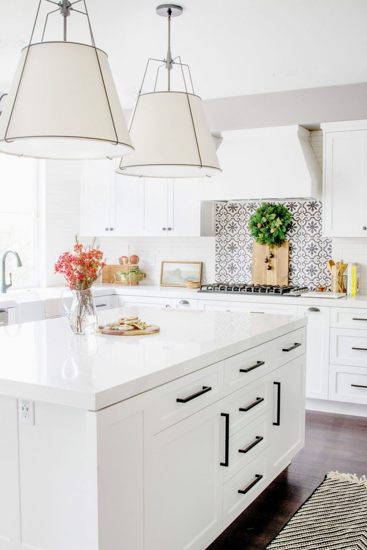 black kitchen cabinet handles on white shaker cabinetry in modern farmhouse kitchen