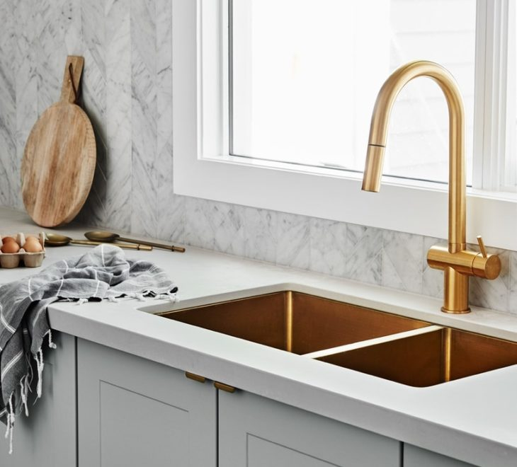 gold tap and gold sink grey shaker cabinets in kitchen norsu