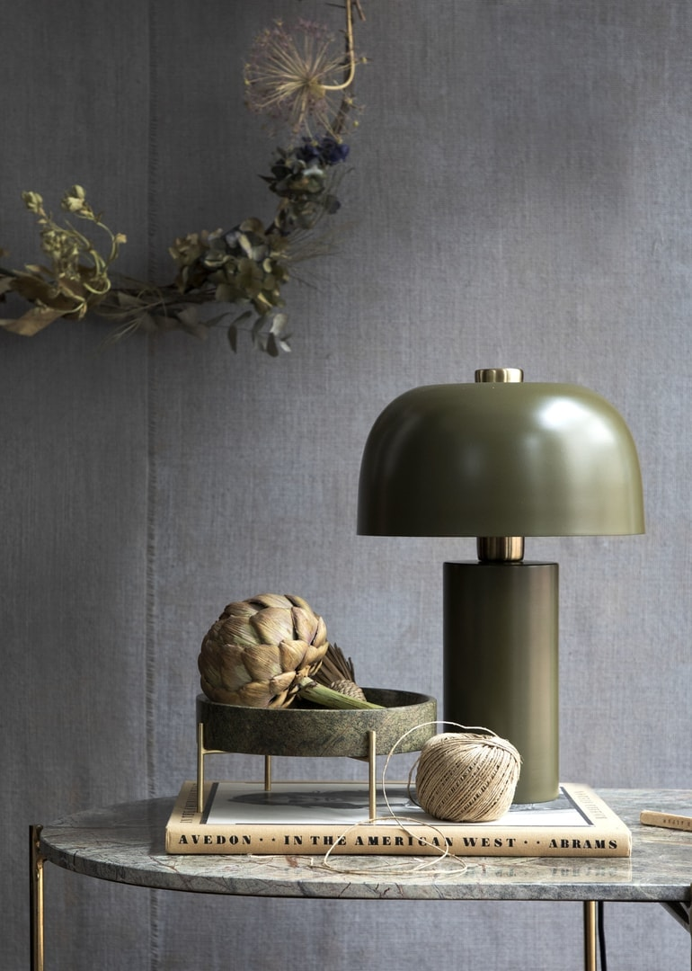 organic bedside table styling with green lamp and ball of twine