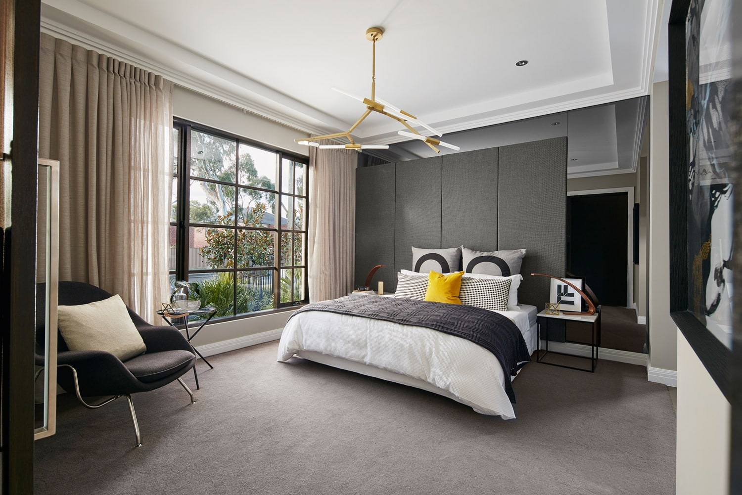 sophisticated master bedroom feature wall panels and tinted mirror behind bedhead