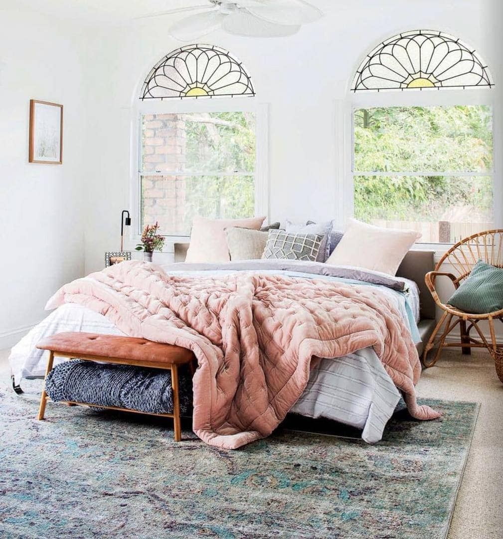zadar rug by miss amara in bedroom with arch windows behind bed