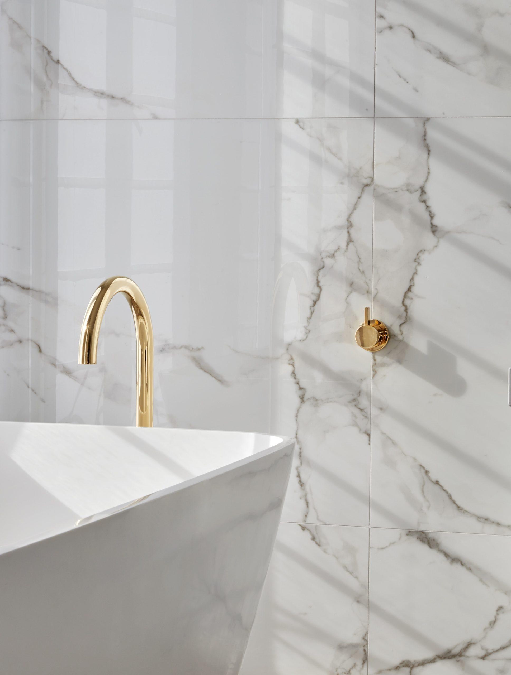bathroom tapware colours brass tap in white marble bathroom metricon