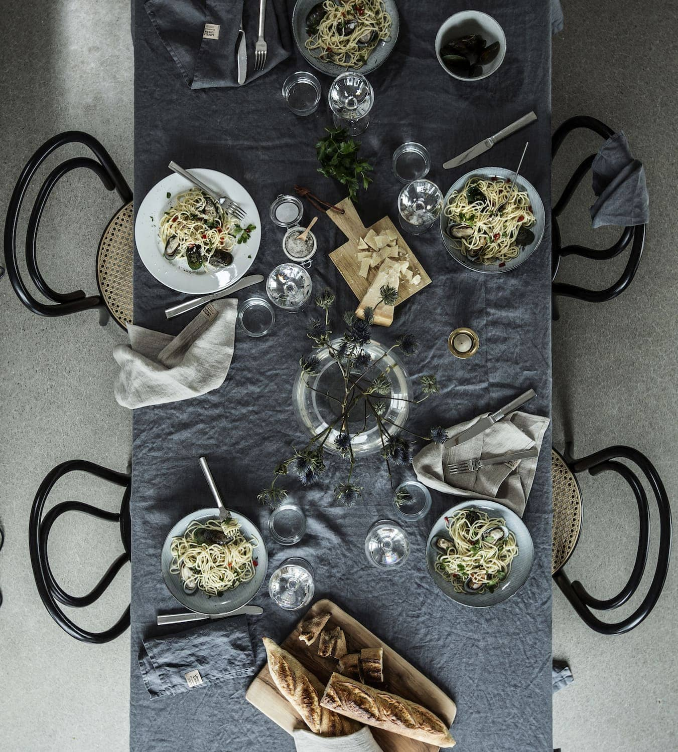 dark grey table linen flatlay dining room with bentwood chairs