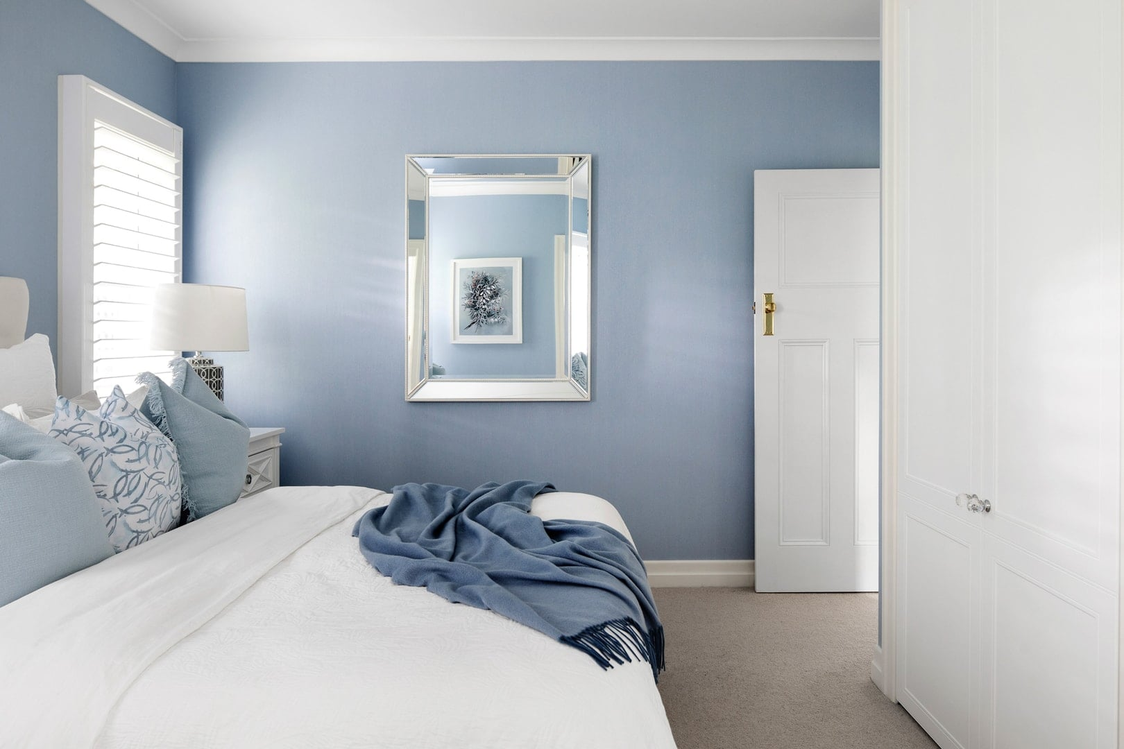 hamptons-bedroom-with-blue-wallpaper-and-white-plantation-shutters