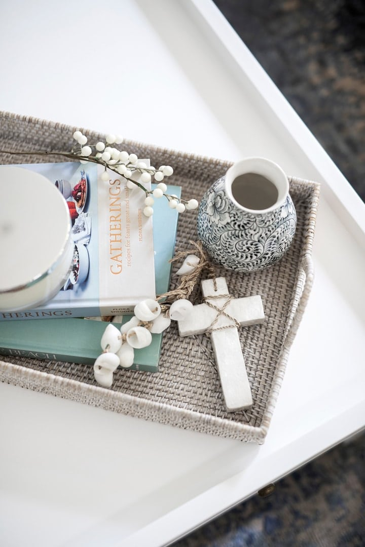 hamptons tray on coffee table with hamptons vignette styling coastal cross ornament