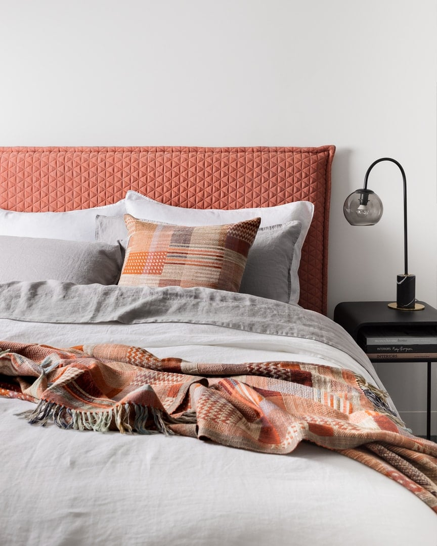 pink upholstered headboard stitcked with grey linen bedding lmhome