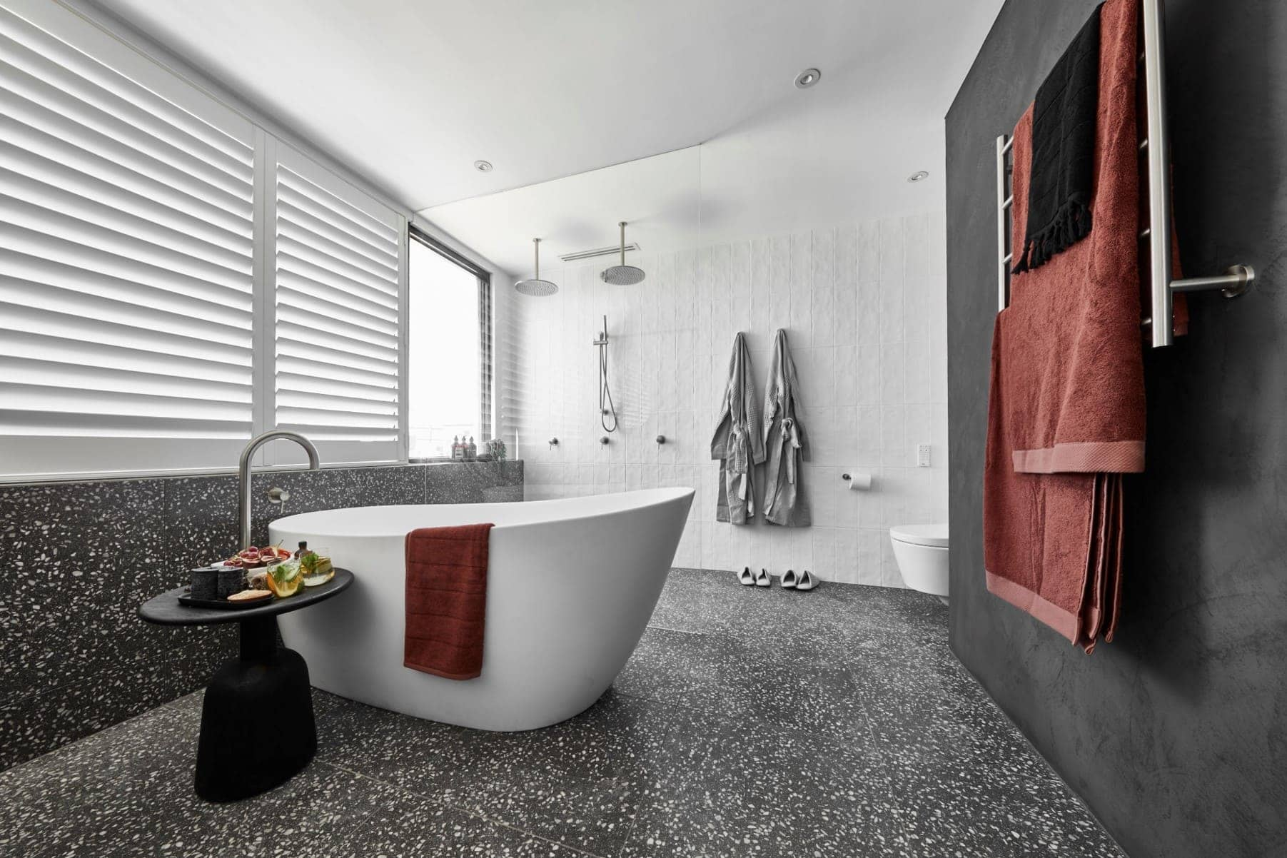 bathroom with terrazzo floor and white walls in black the block tess and luke bathroom