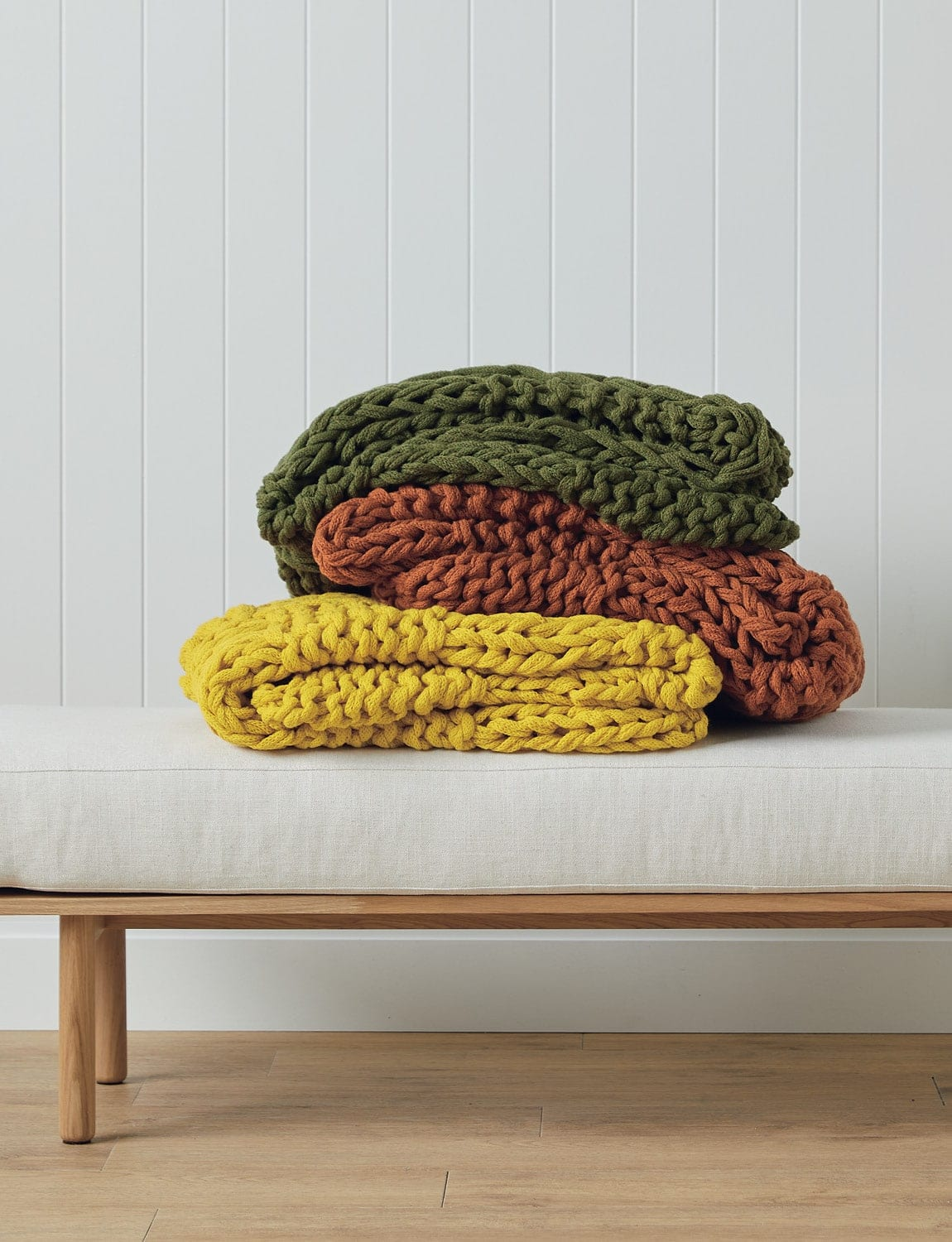 lorraine lea meridian throw blankets in green, orange and yellow chunky knit