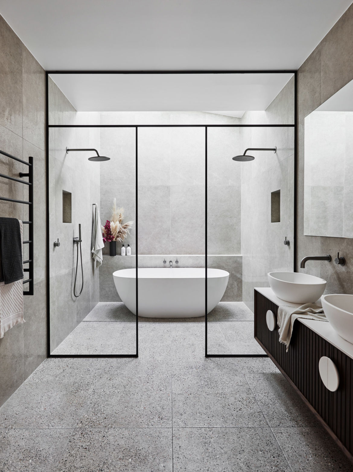 luxe bathroom with walk in shower black frame shower and bath in wet zone 2020 bathroom design trends