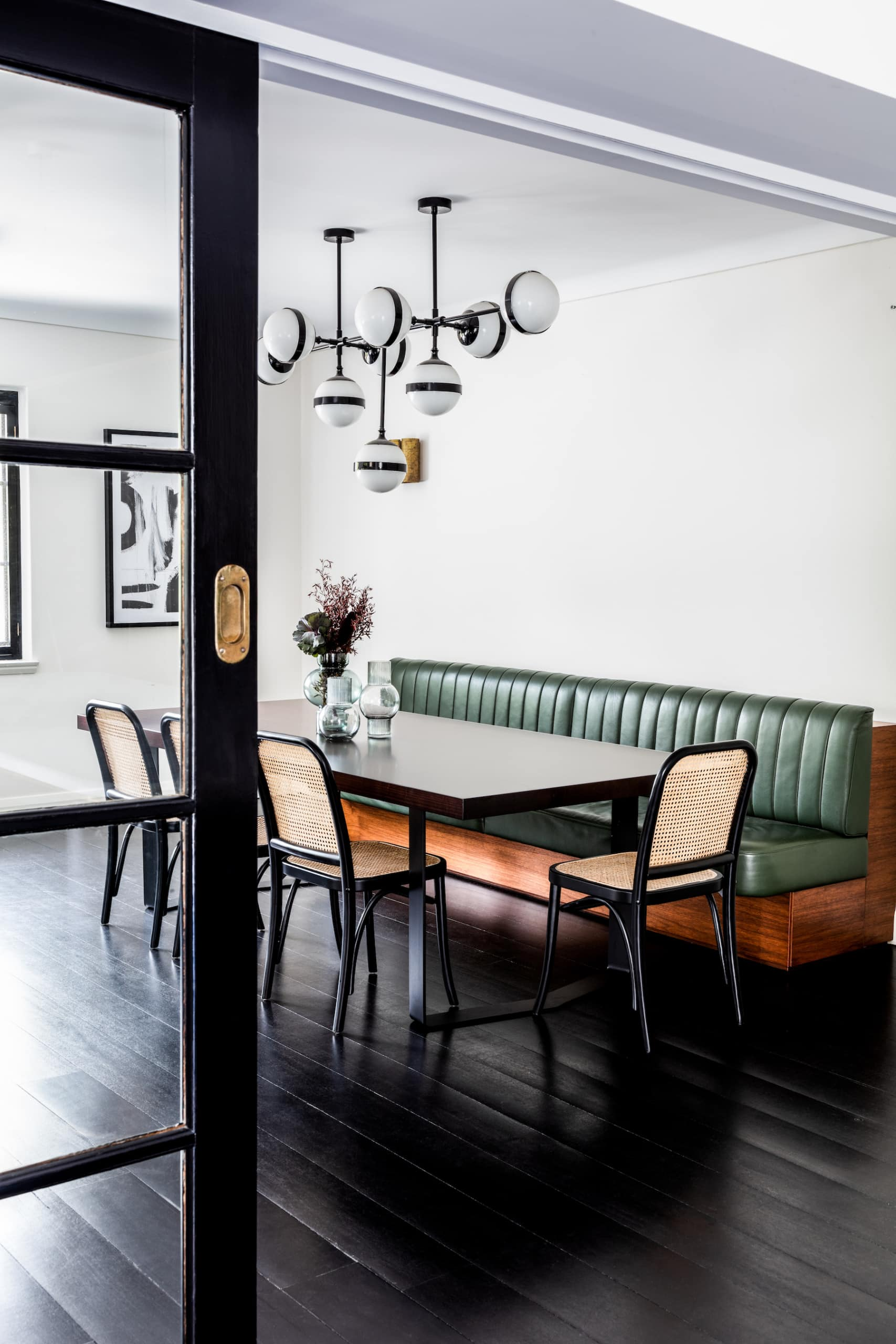 oz design abby dining chairs in chic dining room with leather banquette seating