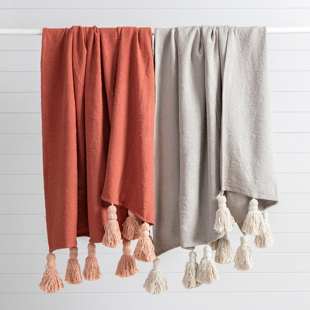 pillow talk chunky tassel throws in orange and grey