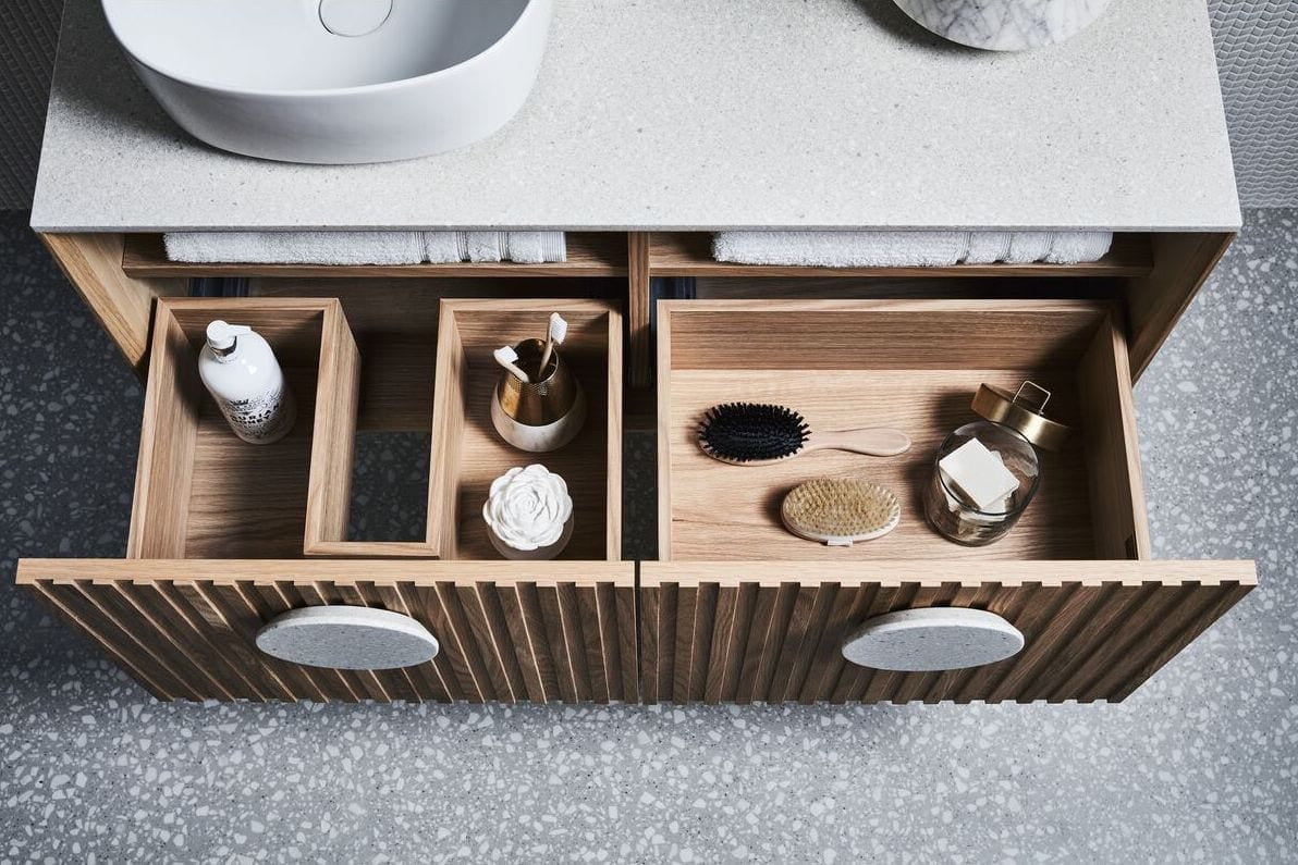 reece zuster issy halo floating vanity with drawers holding hair brush