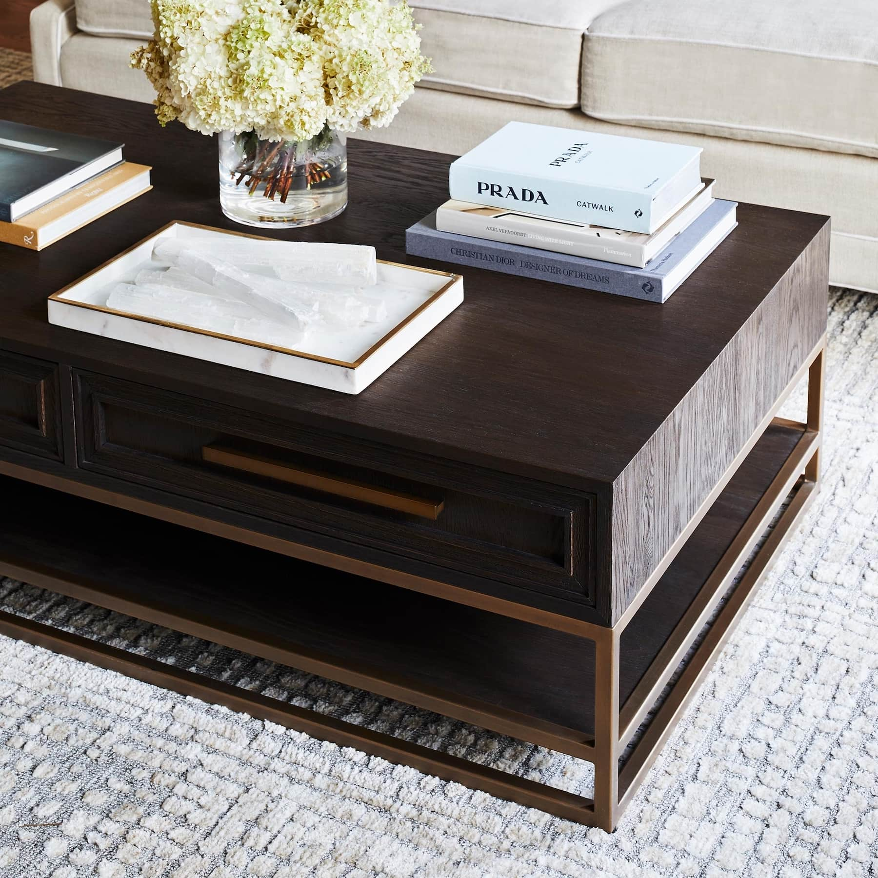coco republic dark brown timber coffee table with stack of books