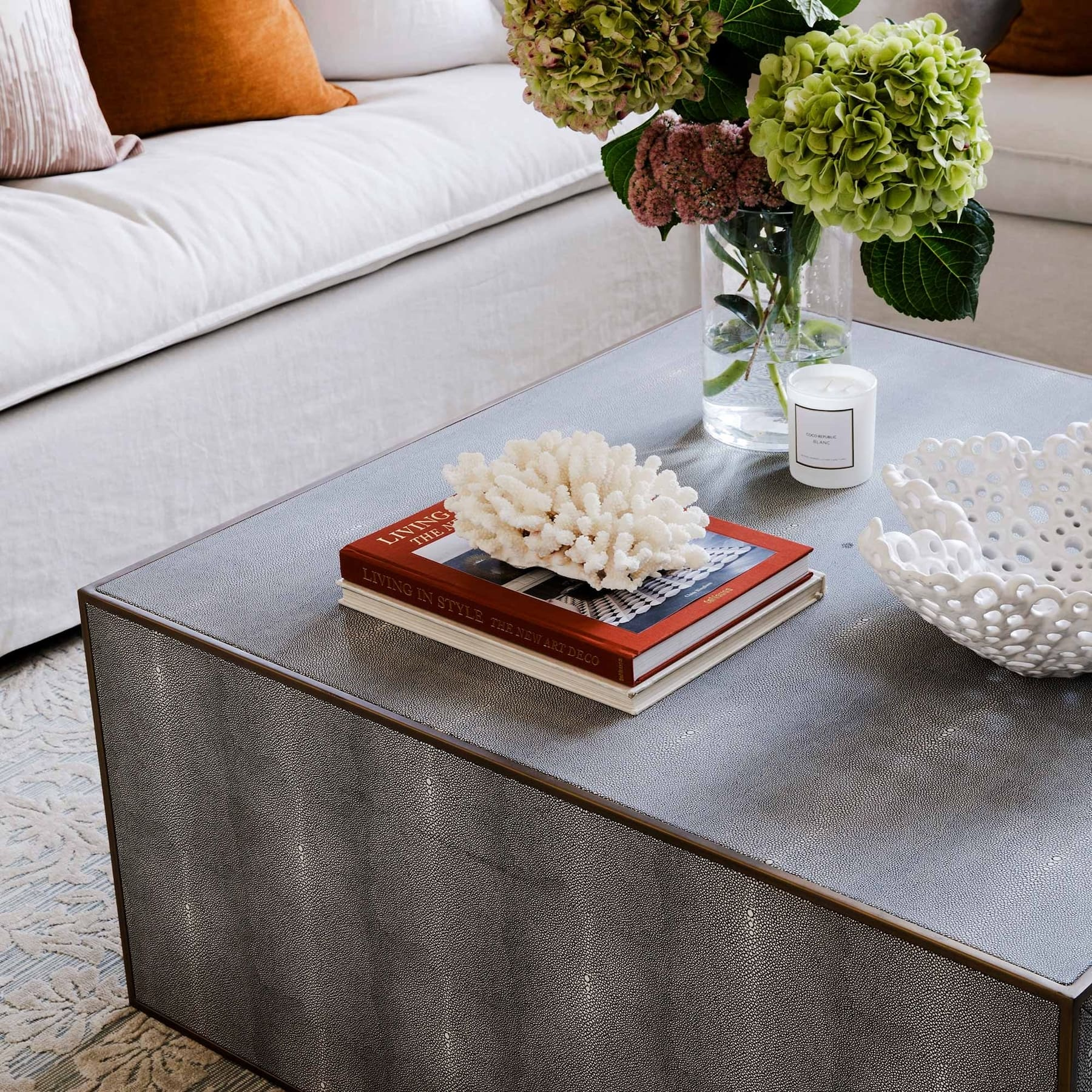 coffee table styling with coral and stack of books coco pepublic