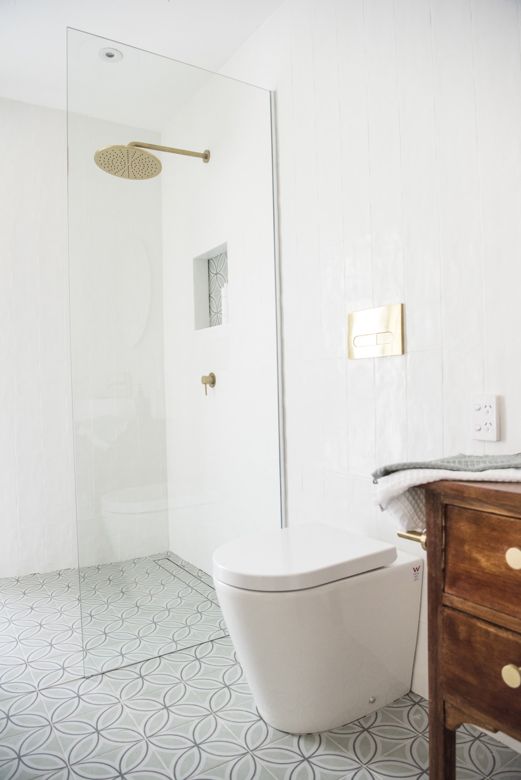 house rules 2020 kayne and aimees house bathroom with white tiles and brass taps