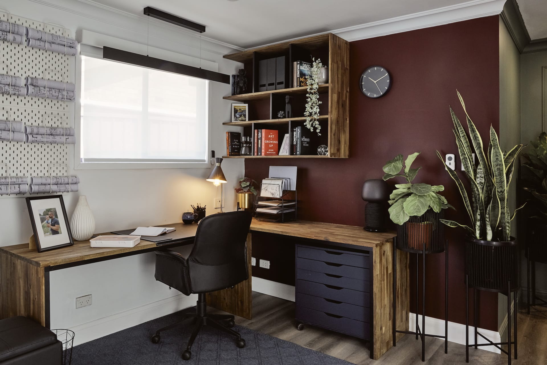 house rules 2020 laith and george home office with burgundy wall and timber shelving