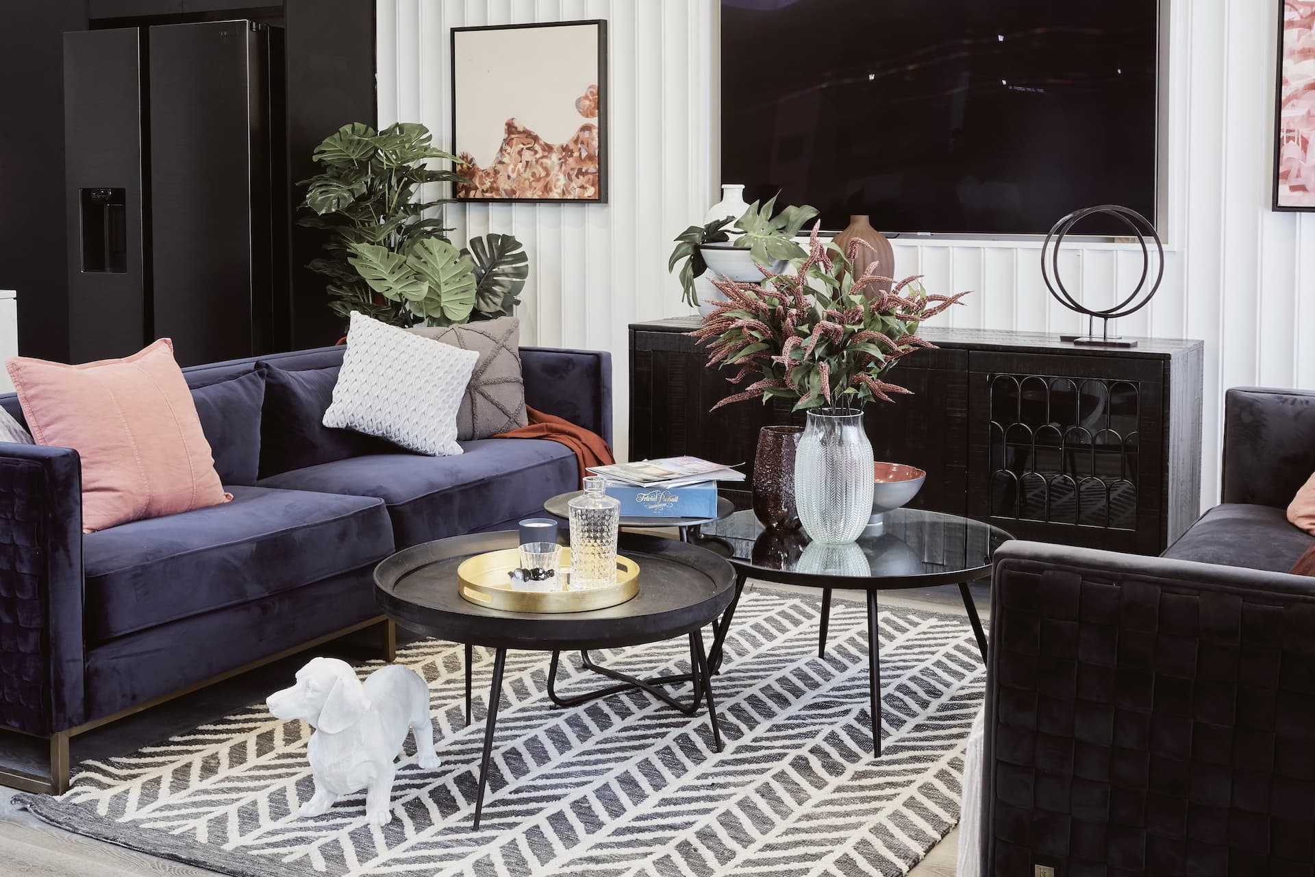 house rules 2020 laith and george living room with blue velvet sofa and round nest of coffee tables