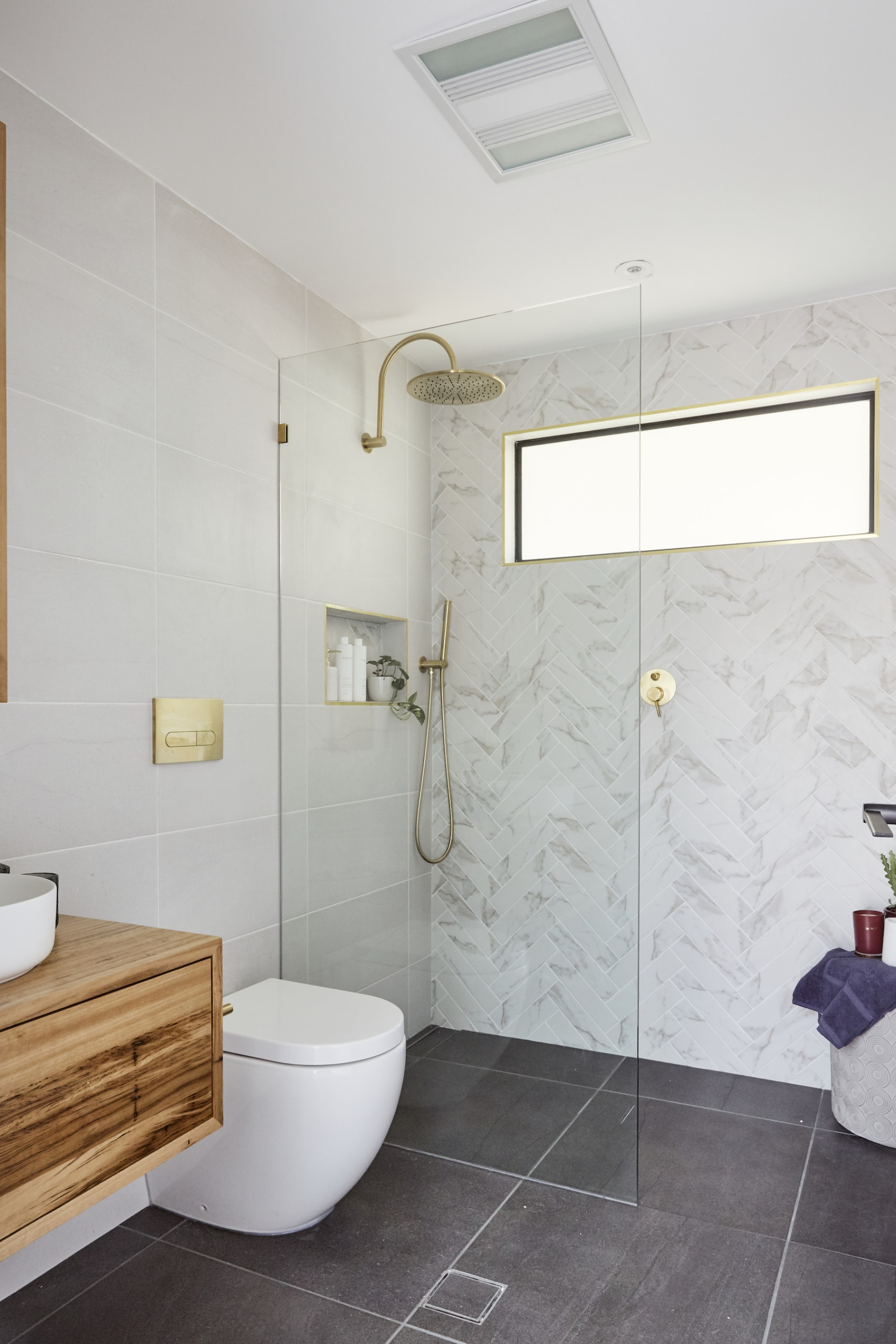 house rules 2020 laith and george white marble bathroom with brass trim and brass taps