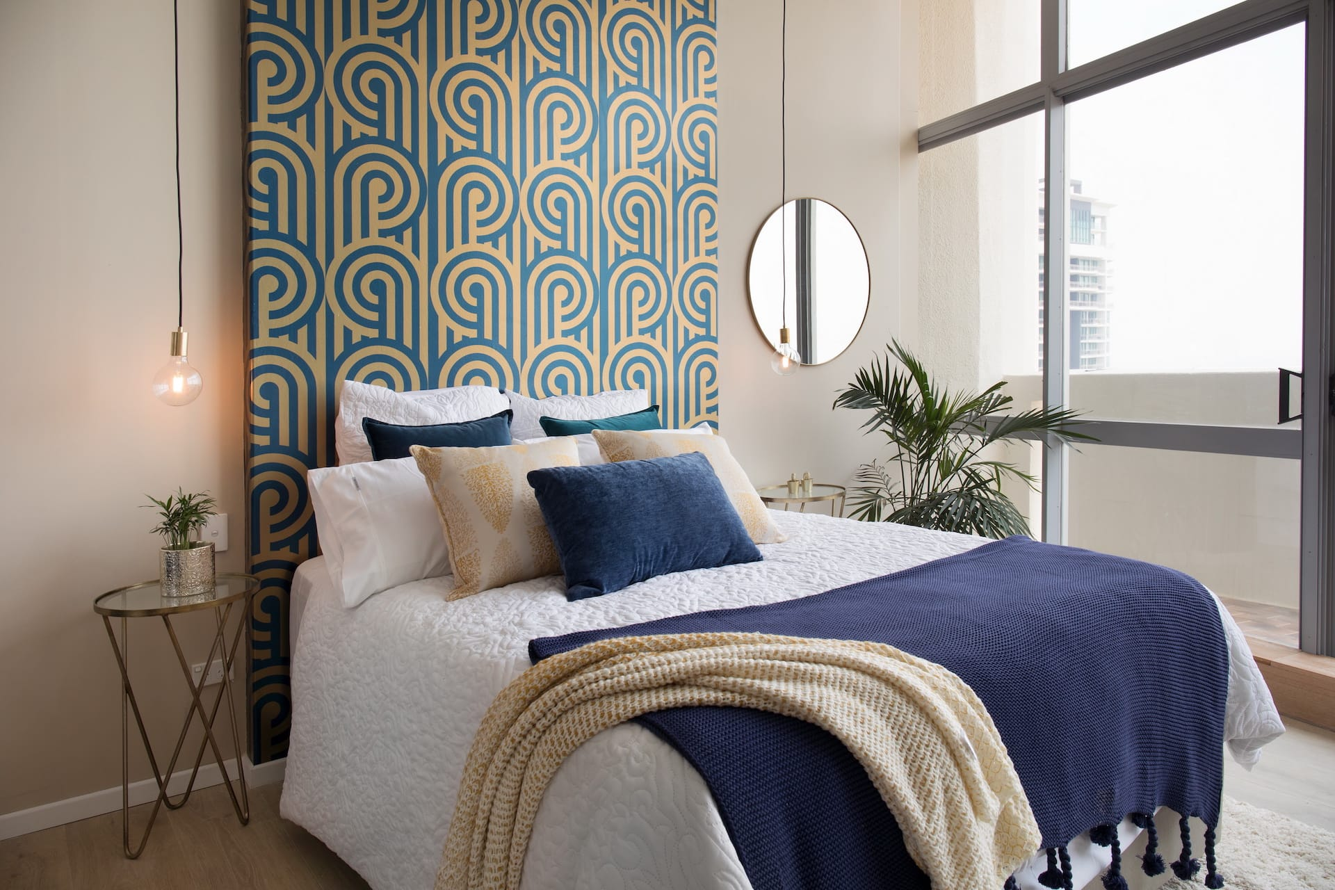 house rules 2020 penthouse reveal bedroom with wallpaper headboard and brass side tables
