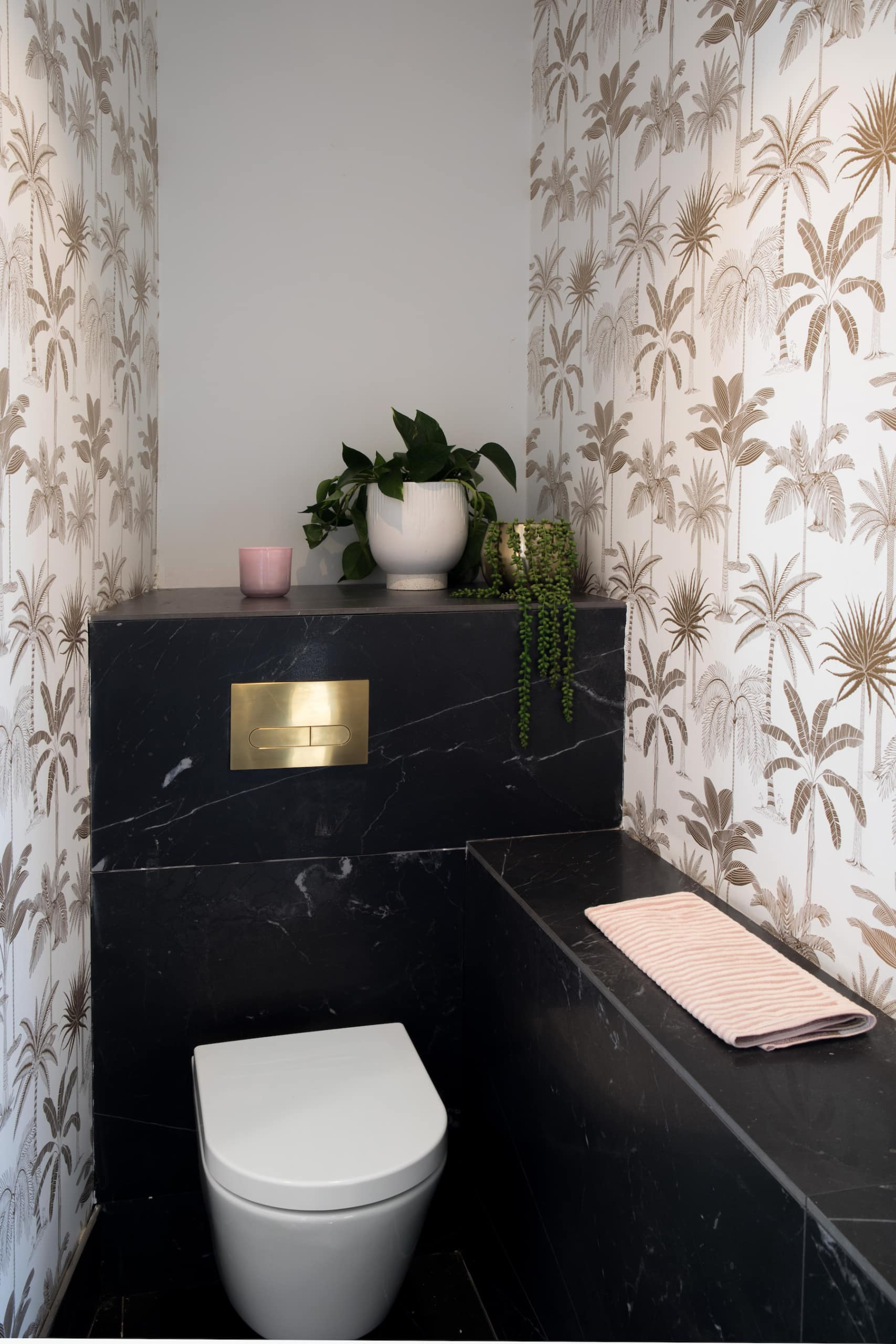 house rules 2020 penthouse reveal powder room with tropical wallpaper