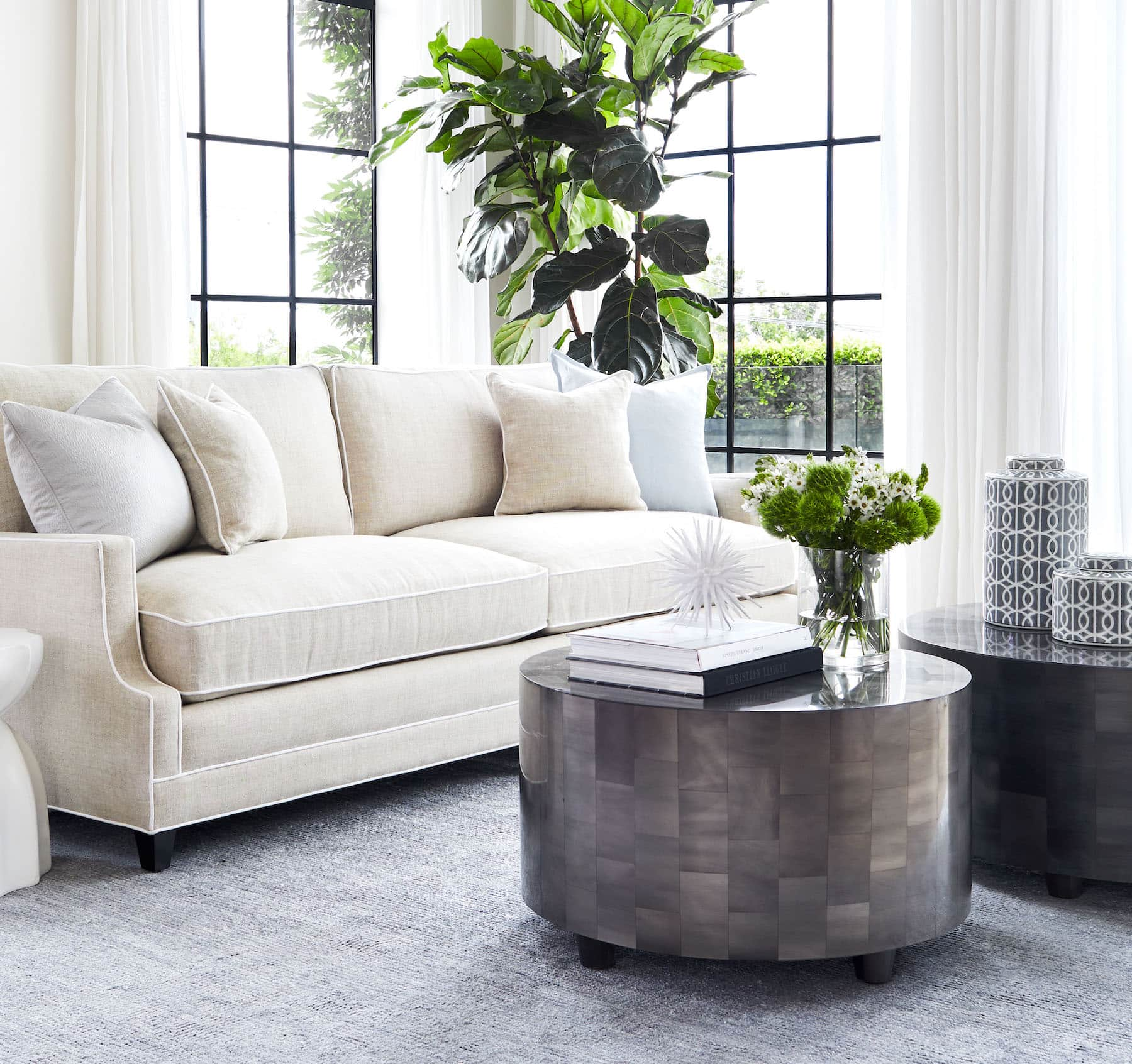round coffee table styling with flowers and stack of books coco republic