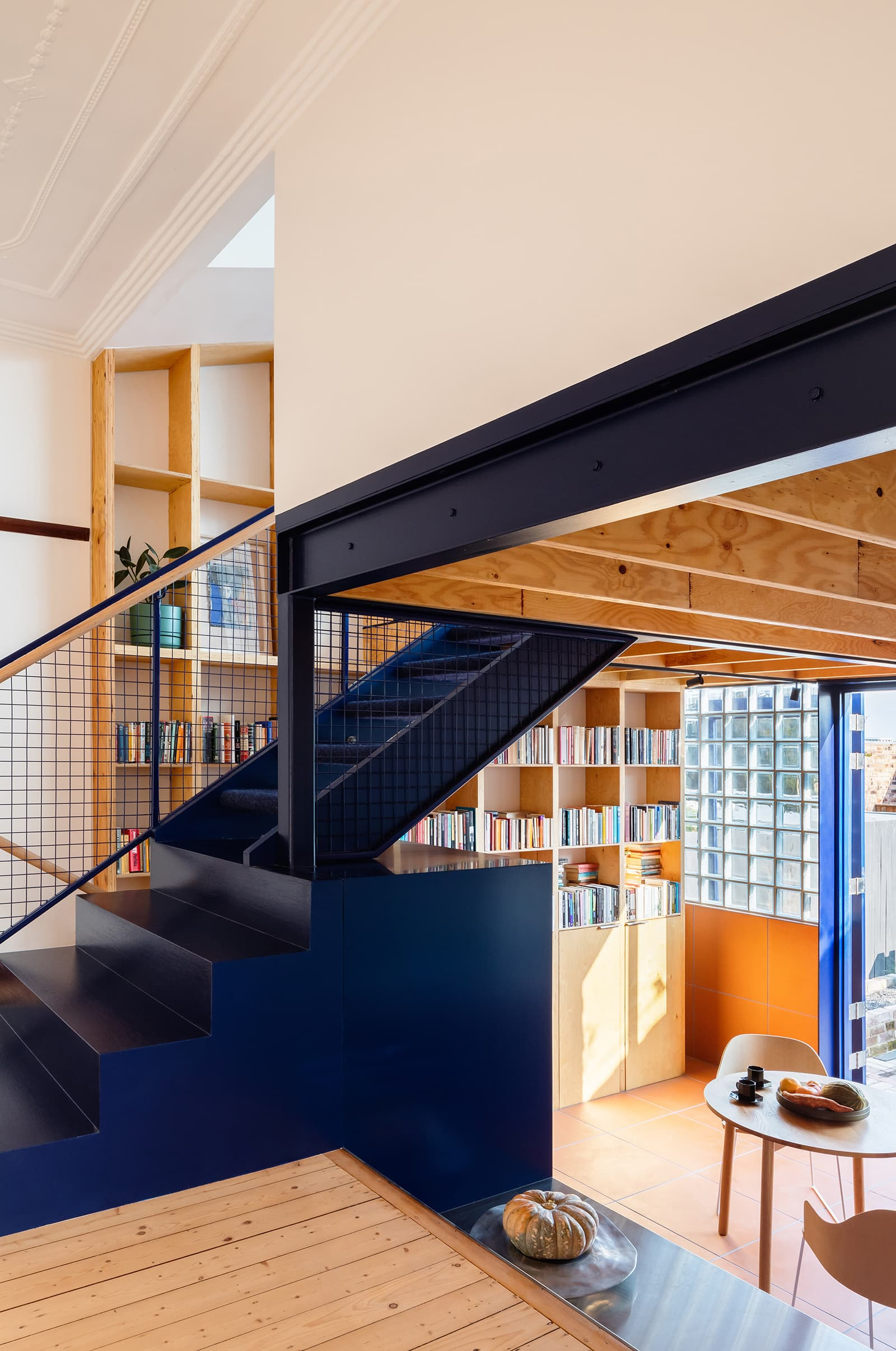 warehouse apartment with navy blue staircase dulux blue lobelia