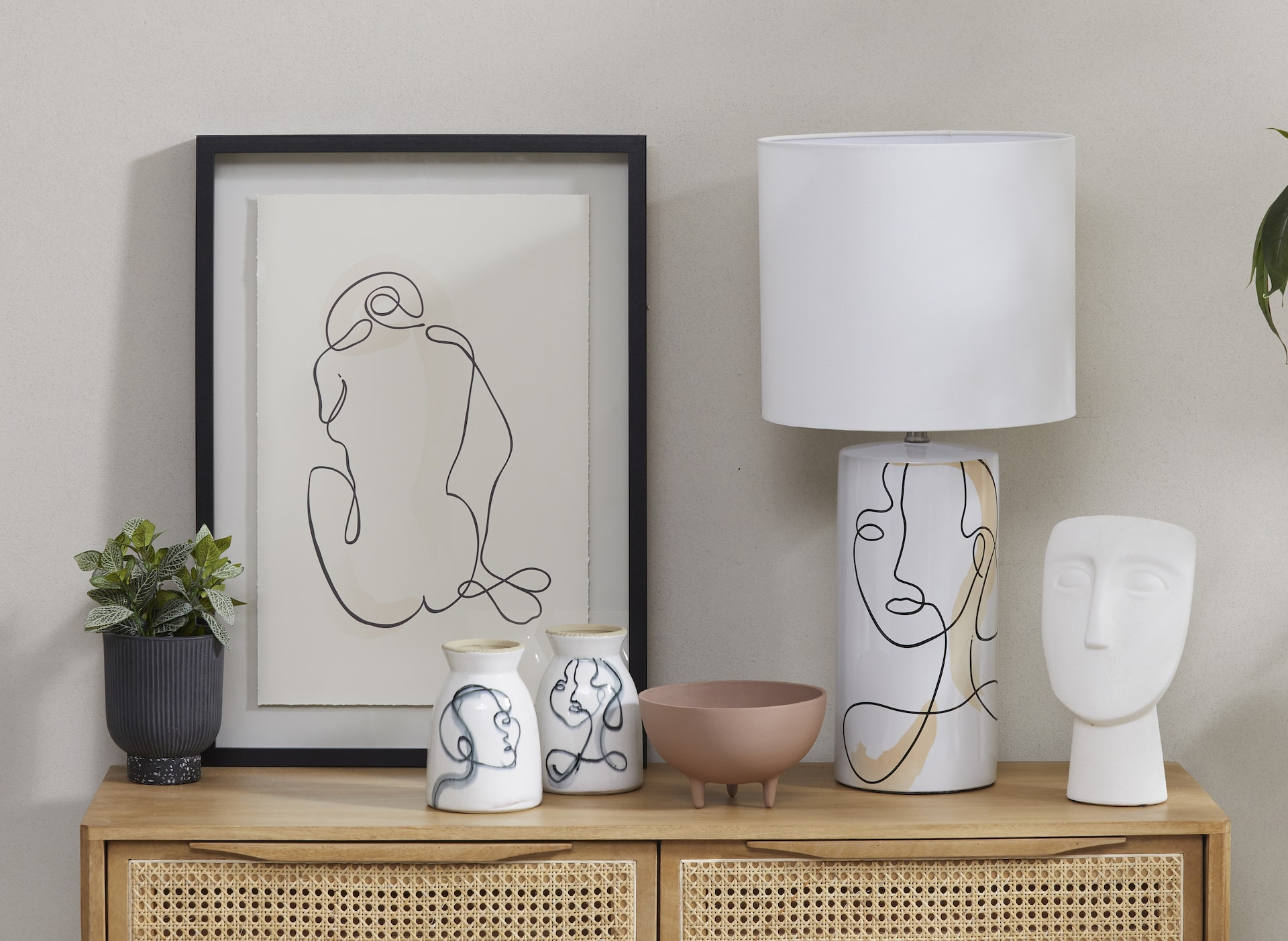 white lamp with face line drawing on the base amalfi albi imports