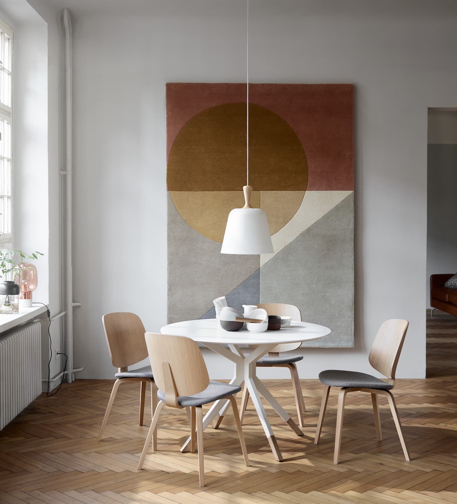 bo concept rug as art in dining room with light timber herringbone floor