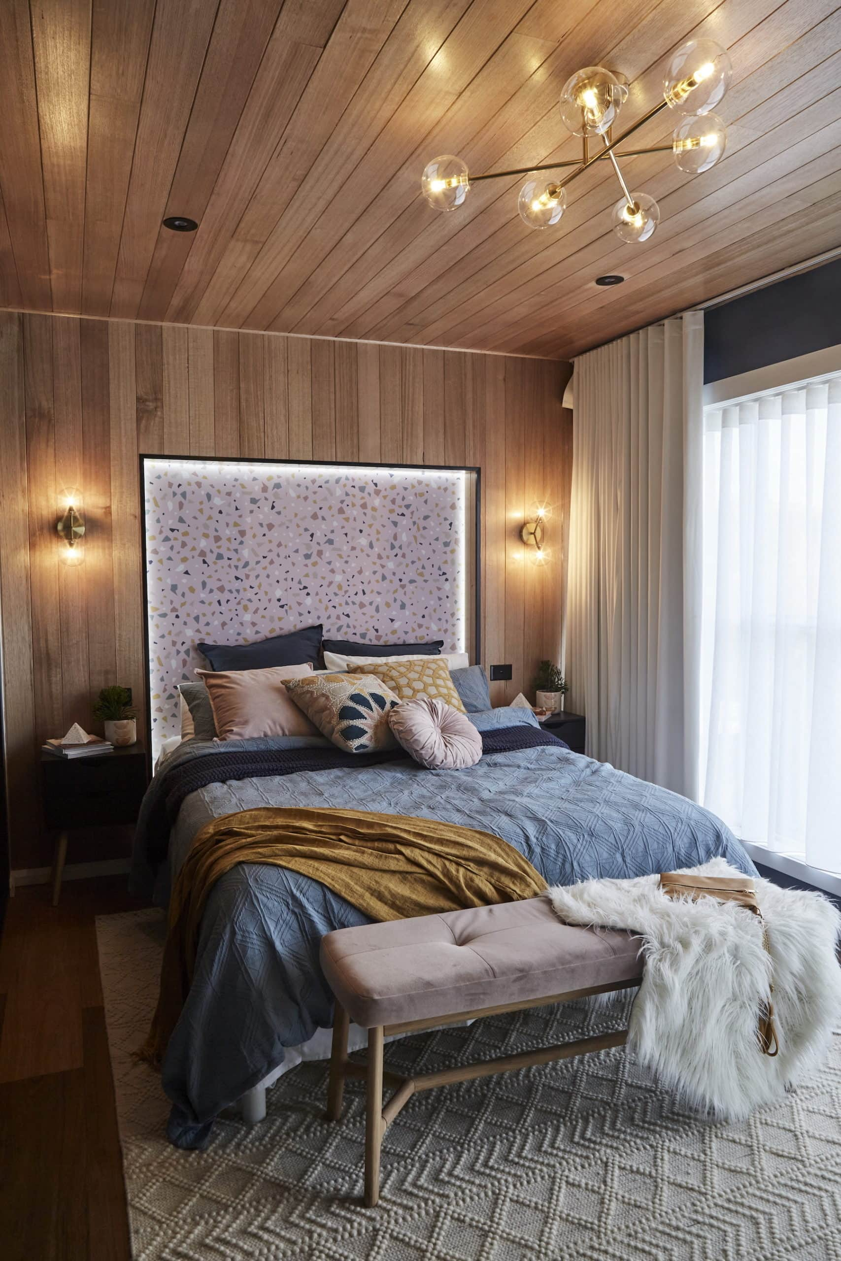 house rules 2020 kimmy and rhi bedroom with terrazzo wallpaper and timber paneling