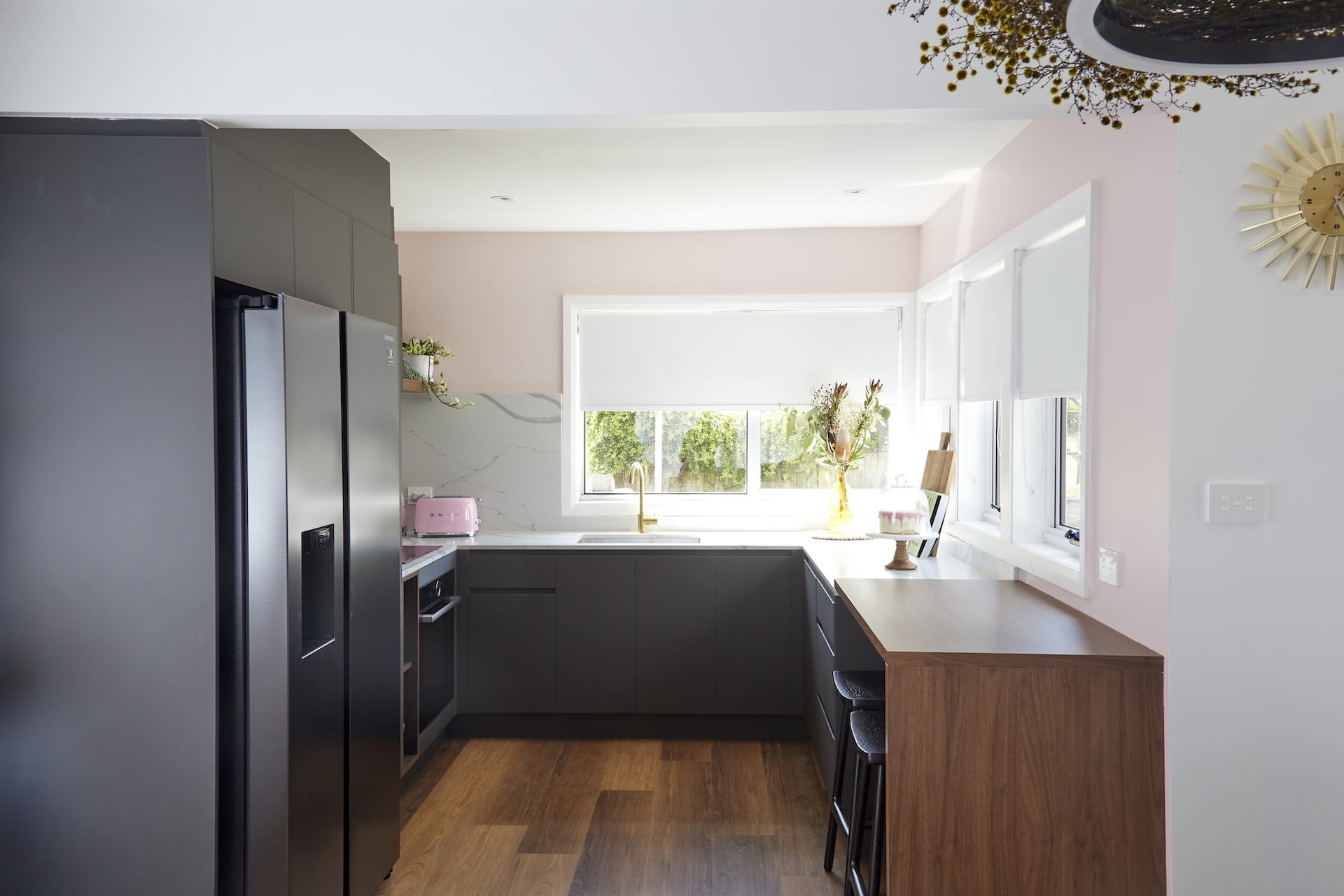 house rules 2020 kimmy and rhi black kitchen cabinets pink walls